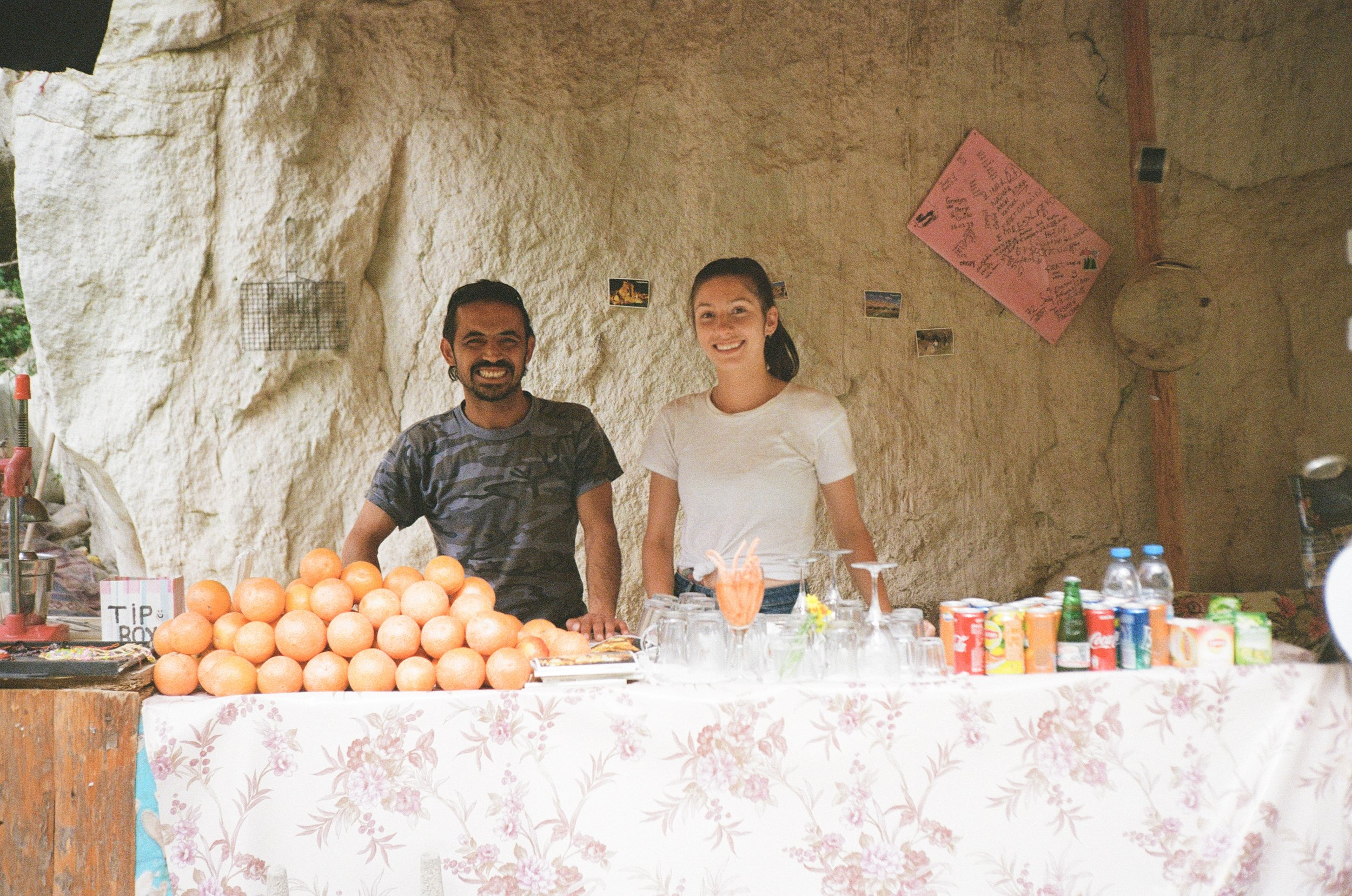 Kelly and Mustapha by his snack stall in 35mm