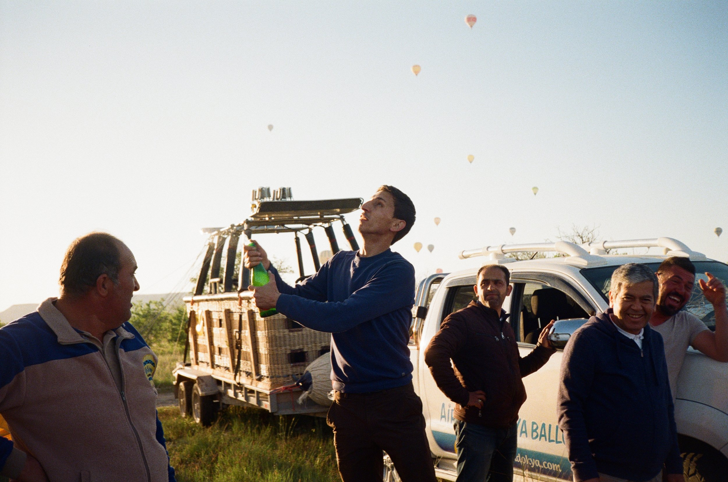 Celebratory flight success champagne toast with our hot air balloon pilot/team in 35mm
