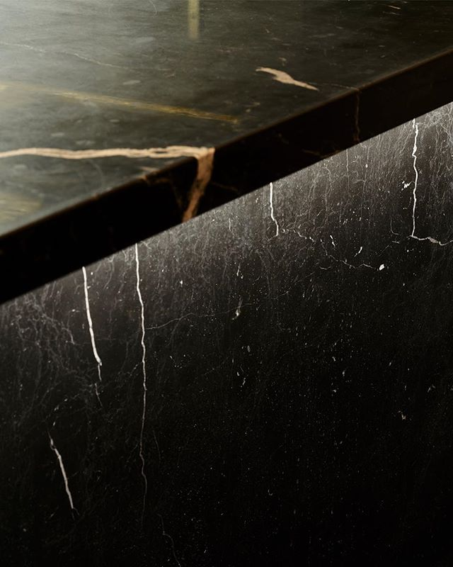 Illuminated black marble detail from kitchen area @missvoonuppsala  _ Interior by @sandellsandberg  Photo by @brendan.austin _ #lighting #lightingdesign #interiordesign #kitchen #material #marble #restaurant