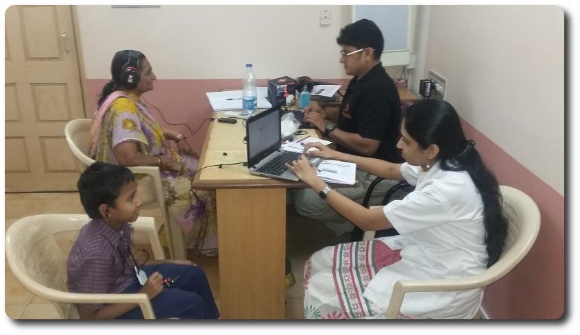 Tirth Dineshkumar Rana getting his hearing tested by Quadio employee, Vaishnavi Bhosale