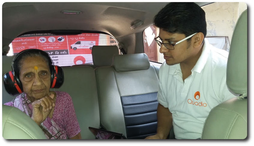 Pushpaben Thakker getting her hearing tested by Quadio employee, Anand Sahasrabudhe