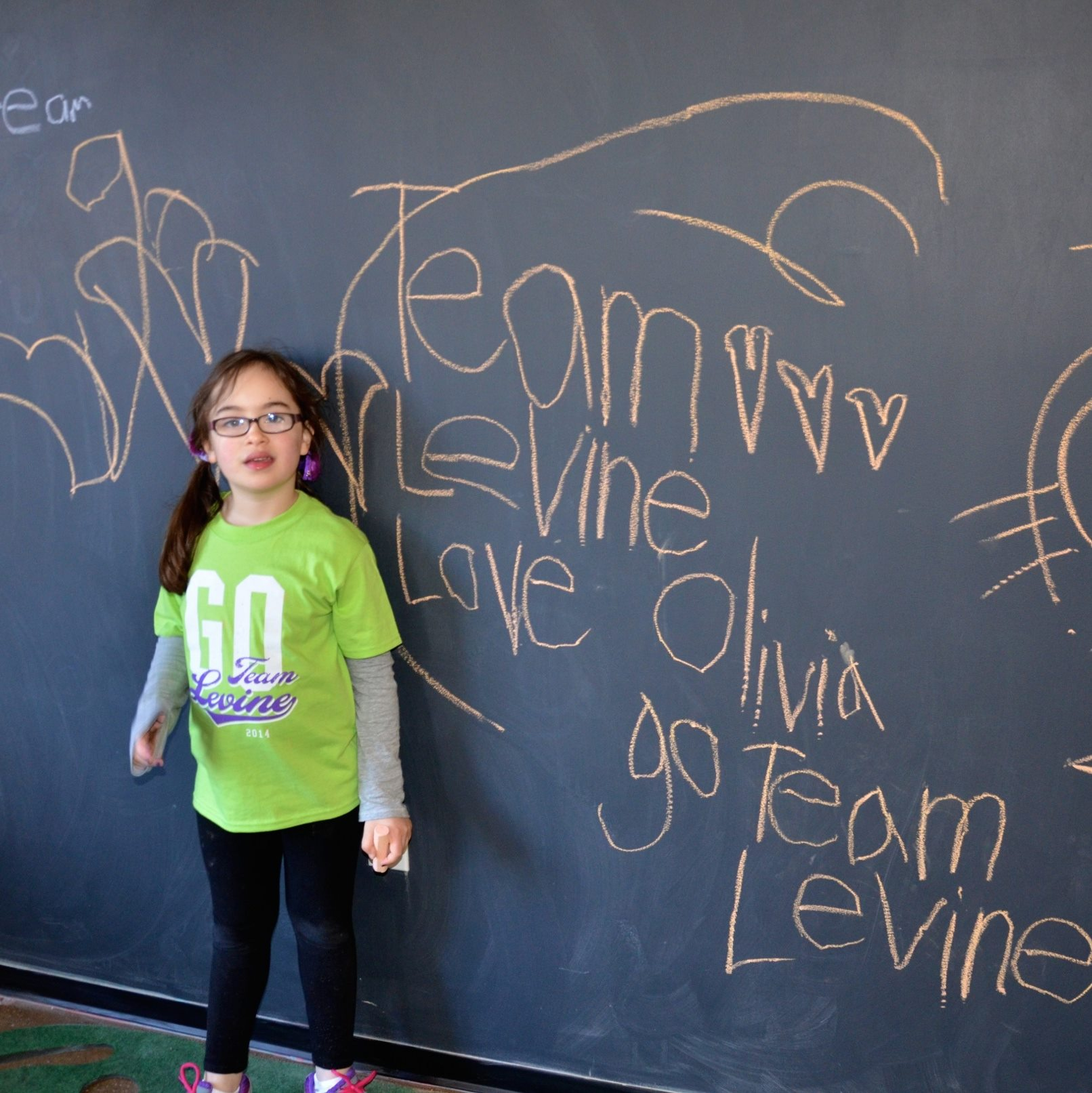 olivia-levine-decorating-the-walls-at-our-post-walk-party-at-ai_16916459881_o.jpg
