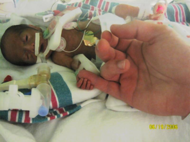 Isabelle holding Josh's hand.
