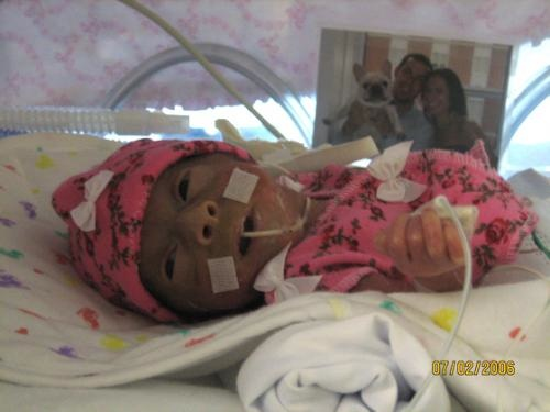 Isabelle dressed up in her first preemie outfit.