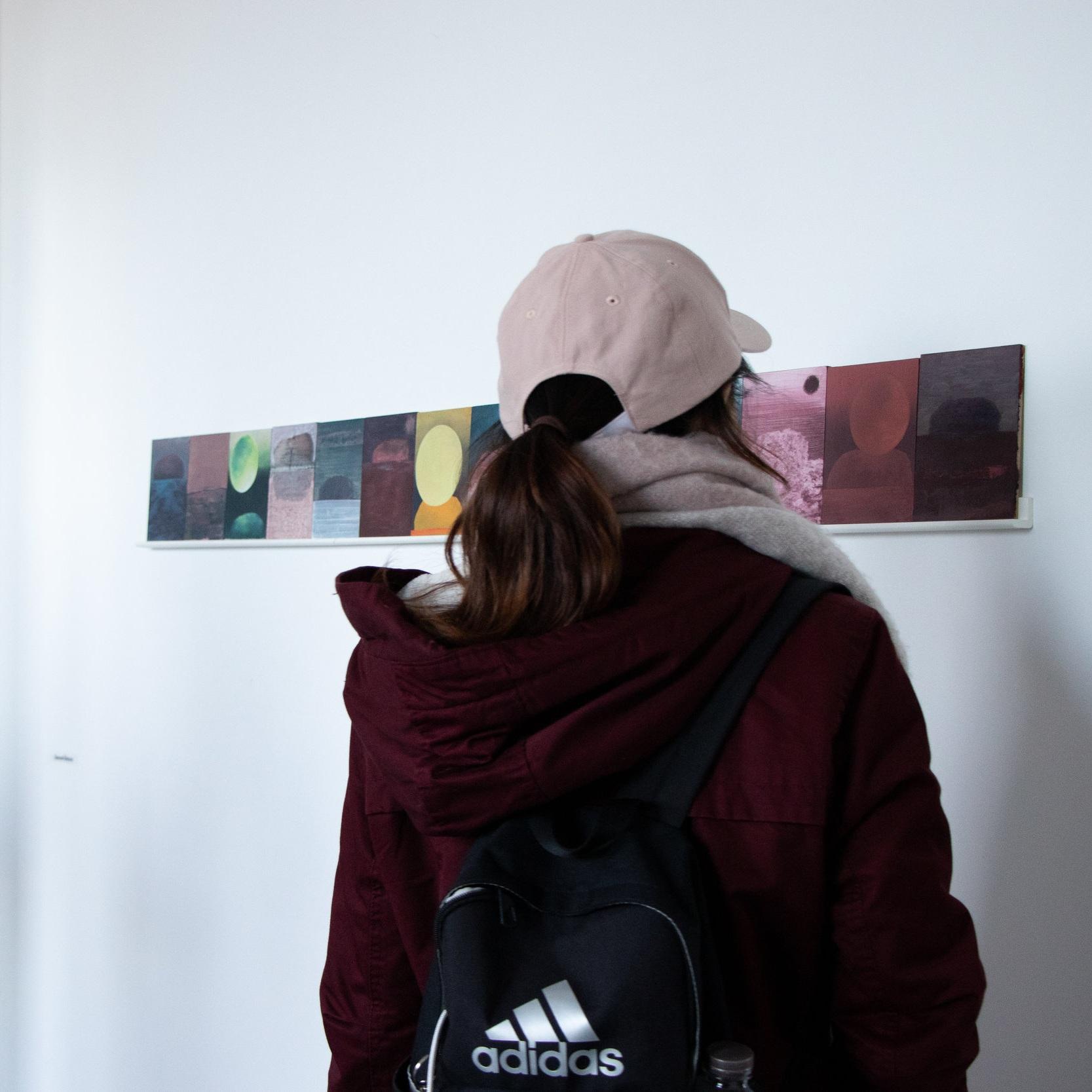 A visitor views Samuel Âhlman's work at Backlit, Nottingham. Photo by Mel Malkin.