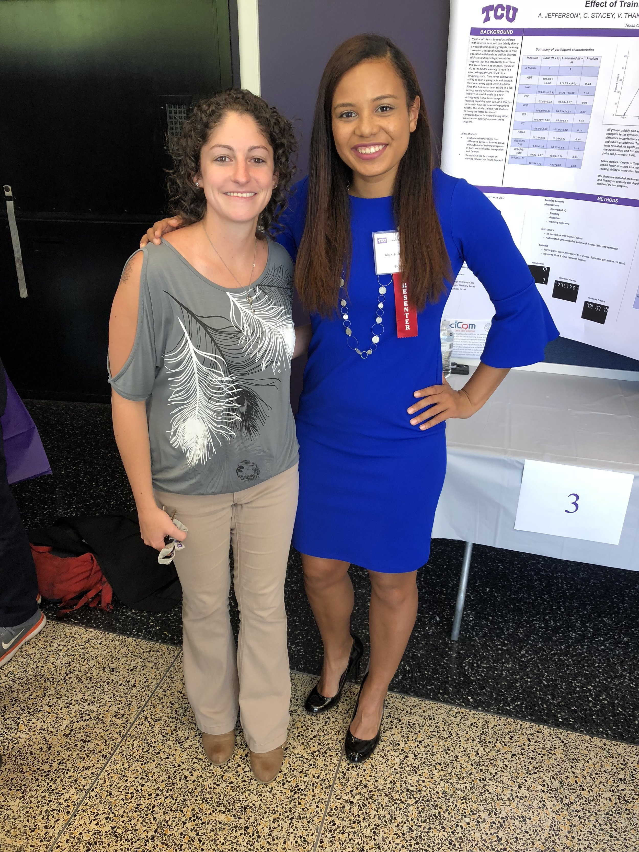 The Centanni Lab's first research poster! - Lab director Tracy Centanni (left) with lab undergrad Alexis Jefferson (right) as she presents the first research poster out of the lab! Alexis received a TCU Students in Research grant this year to study the effect of training approach on novel letter acquisition. The poster was very well received by the community.-April 2018
