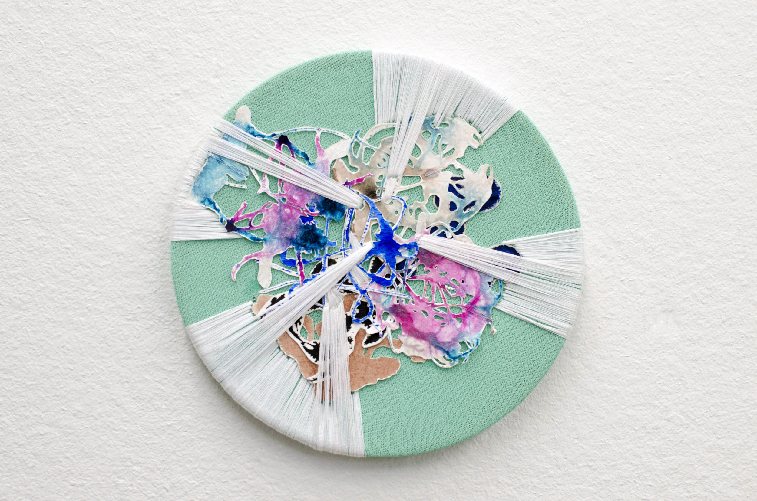 Emma Balder,  Spinning  (2014), Acrylic, paper, and thread on fabric, 7 x 7 inches