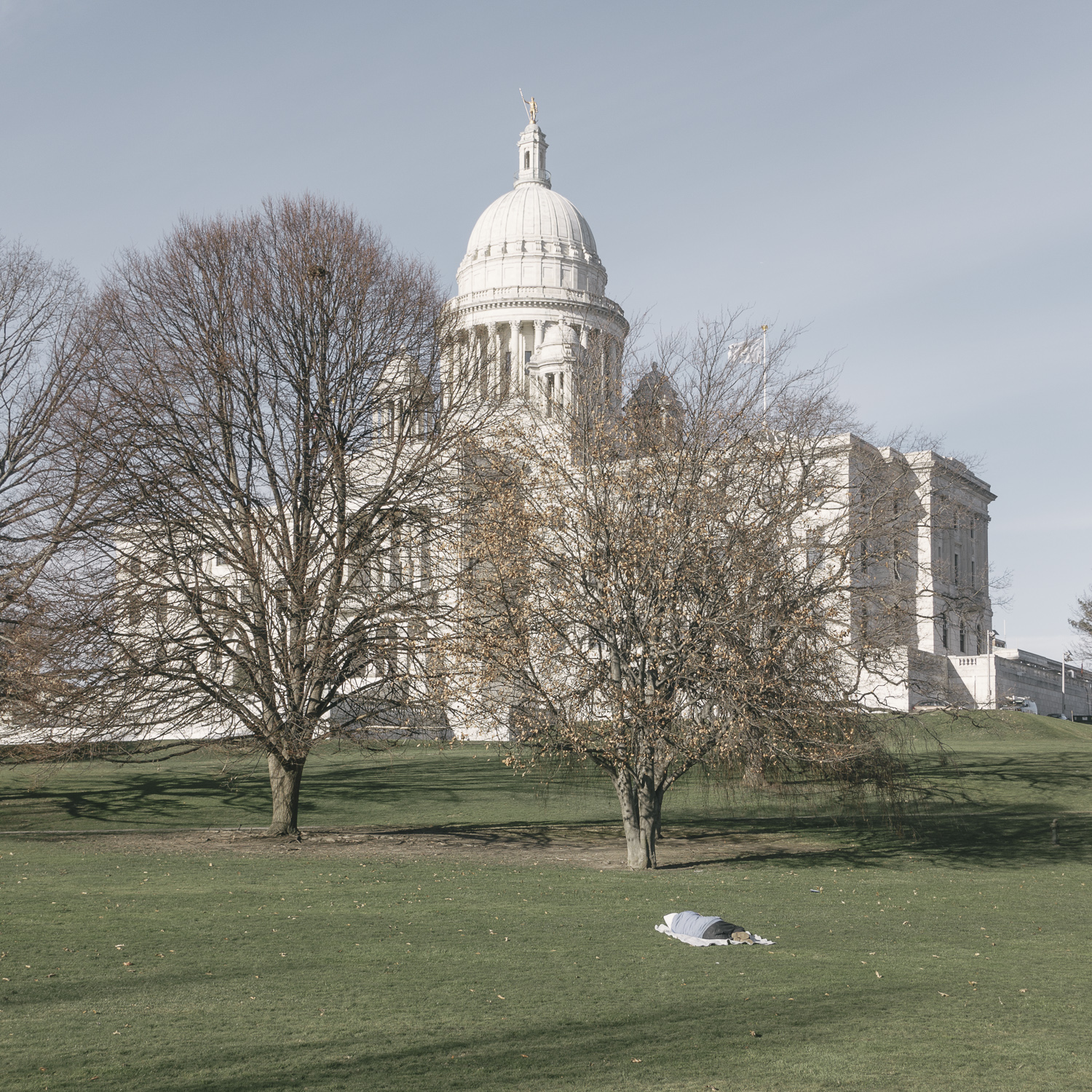 untitled (man sleeping on state house lawn) , Providence, Rhode Island, 2015