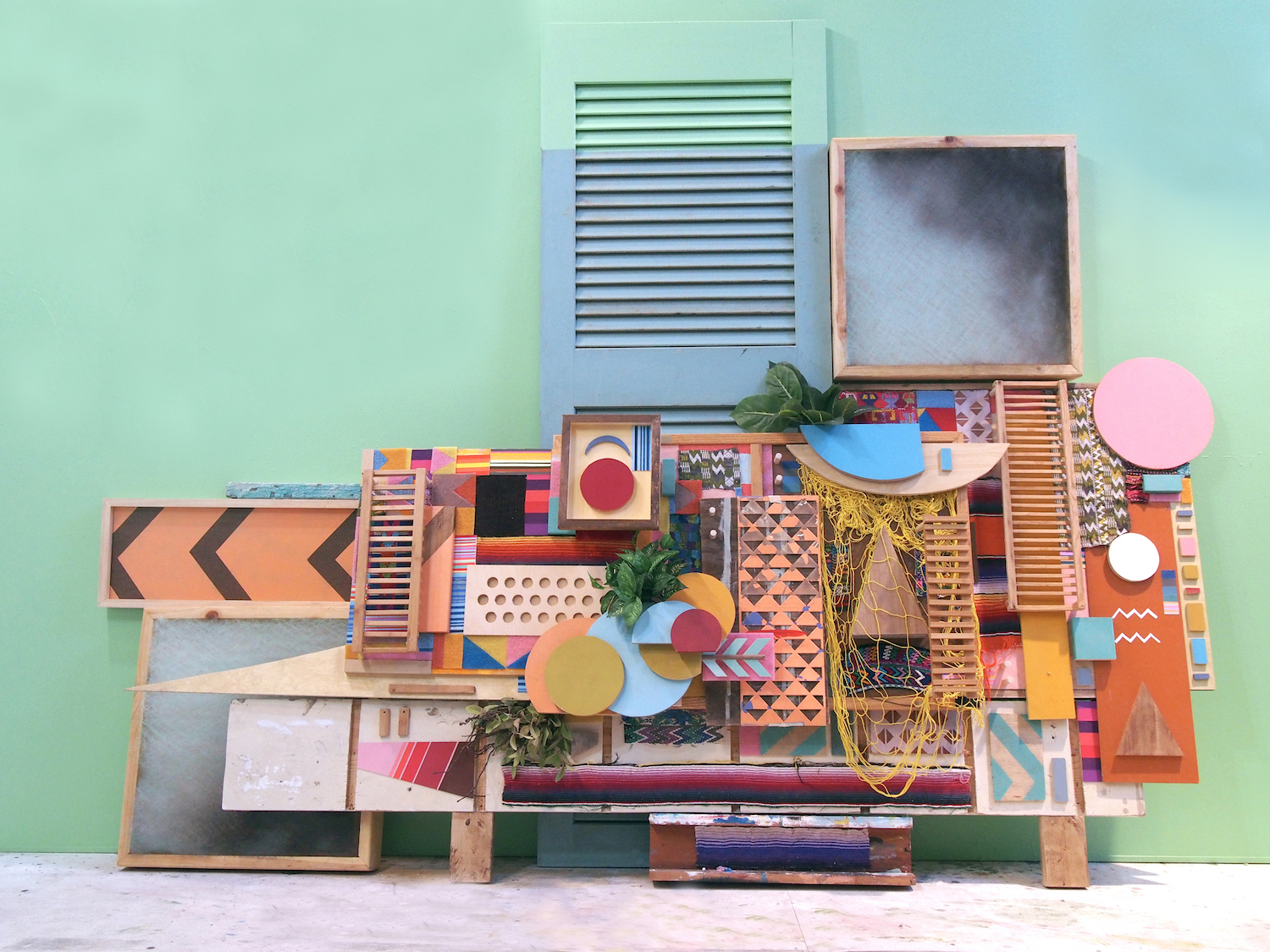 100x156x20 , wood, metal, paper, scouring pads, Guatemalan textiles, woven serape blanket, net, thread, stain, plastic stencil, acrylic paint, air filters, found items, artificial plants, 100 x 156 x 20 inches