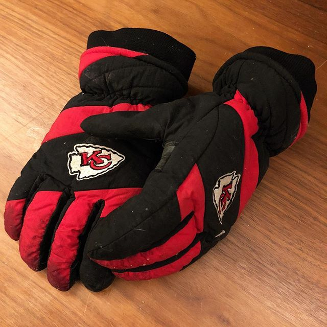 "These were my dad's gloves. I got them for him several Christmases ago. His reaction upon opening them is still so real. I can clearly hear him saying, ""Oh boy!"" as he pumped his fist in the air. He loved the Chiefs. When he died, I asked my mom if I could keep them.  Last Sunday, I was at Arrowhead Stadium, cheering on the Chiefs (along with 75,000 other people). The tickets were a gift for my upcoming 30th birthday from my father-in-law. Given the harsh temps, I decided to wear my dad's gloves.  For 3 1/2 hours, I clapped my hands. The muted claps of his puffy gloves brought tears to my eyes. I held the gloves against my mouth, forming a pseudo megaphone, as I yelled at the top of my lungs. Meanwhile, it's as if a part of him was there with me.  I'm thankful for memories. I'm thankful for mementos. I'm thankful that at the loss of one loving father, I've gained another in my father-in-law.  Today is my dad's birthday. Chances are he would've received a barrage of Chiefs apparel. That was our go-to gift. Happiest of birthdays, old man. I miss you dearly. Wish our boys could've got you the ""W."" I guess I'll have to get the gloves back out next year.  DISCLAIMER: the picture of Mal & myself is not from last week, but it deserved to be seen nonetheless.  #chiefskingdom #chiefsnation #kcchiefs"