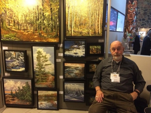 """Here you see Lynne""""s husband Grant at her booth in the Mcmichael Show in 2017."""