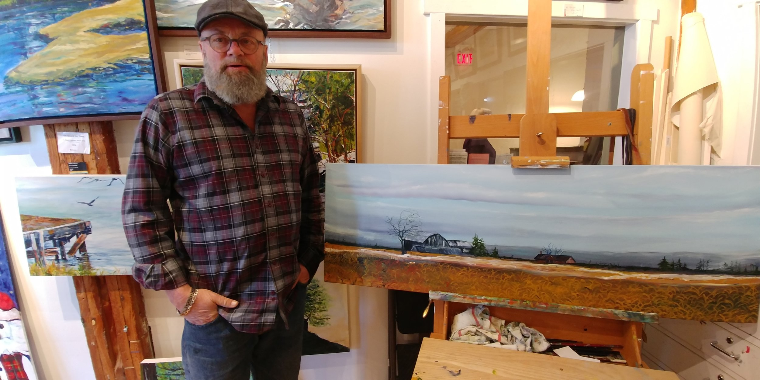 Robert standing beside his almost finished painting.