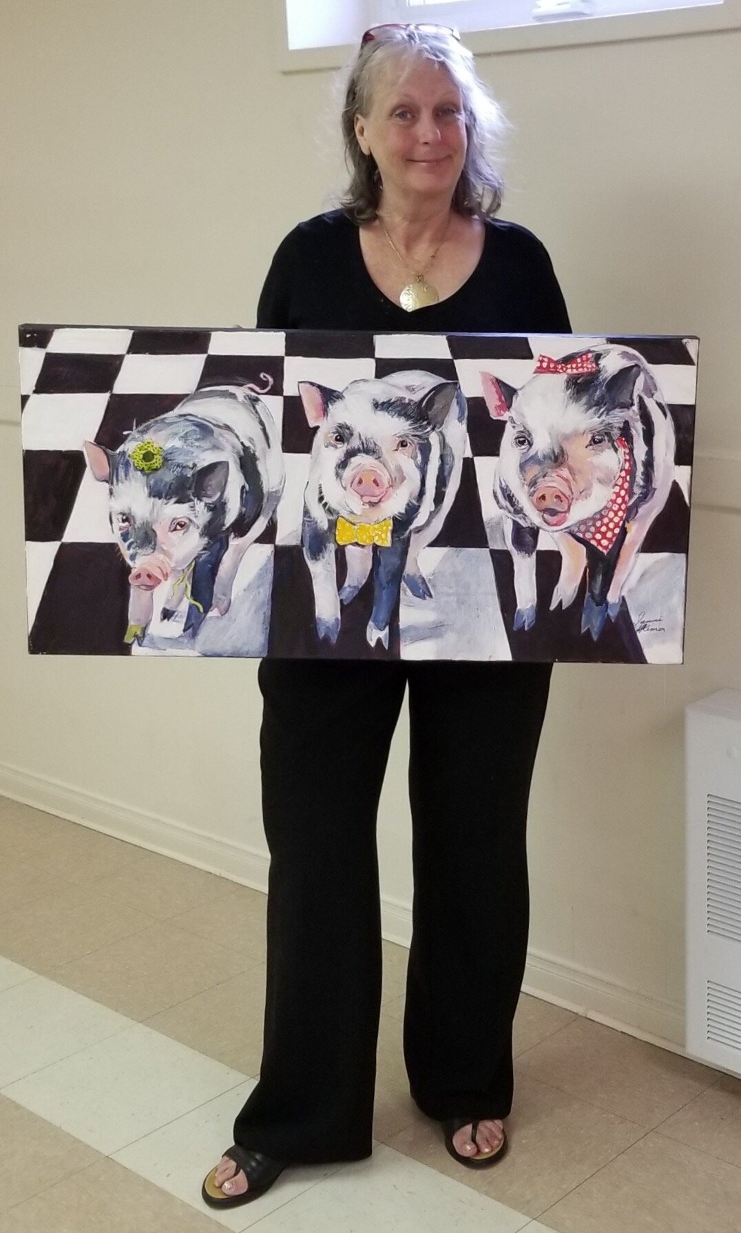 Artist Janice Ykema with her artwork titled Out to Lunch
