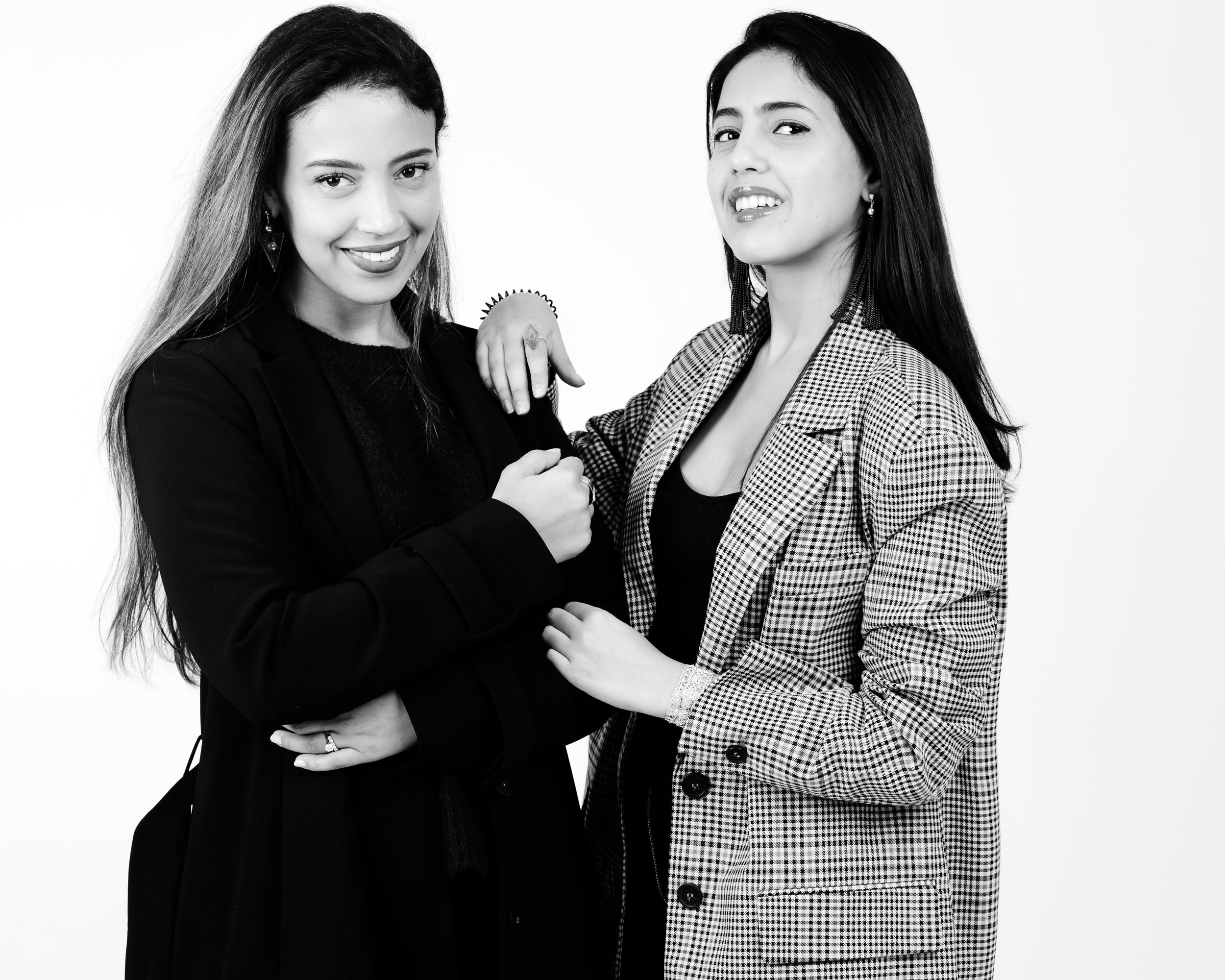 Founders - We are two founders and sisters with very different strengths. However, we complete each other perfectly.Based in New York, Zineb is the designer and co-founder of the brand. She is constantly looking for new ways to combine tradition and trend through her jewelry designs. She gets greatly inspired by the traditional tribal signs of Morocco which enable her to create collections with strong aesthetic that hint the brand origin. Also, Zineb's previous studies at Studio Jewelers in New York helped her improve her expertise and stay in touch with the latest design trends.Based in Casablanca, Rim is the CEO and co-founder of the brand. In Morocco, she works in close collaboration with Moroccan artisans. She assures the quality of the pieces to offer jewelry that has a long-lasting value (as promised in the brand's mission!). Also, Rim has a masters degree in e-commerce at the renowned school of business, HEC Montréal. She uses her knowledge and skills to create a unique online shopping experience through a user-friendly website, strong social media presence and frequent content creation (blog articles).In this photo, from left to right: Zineb & Rim