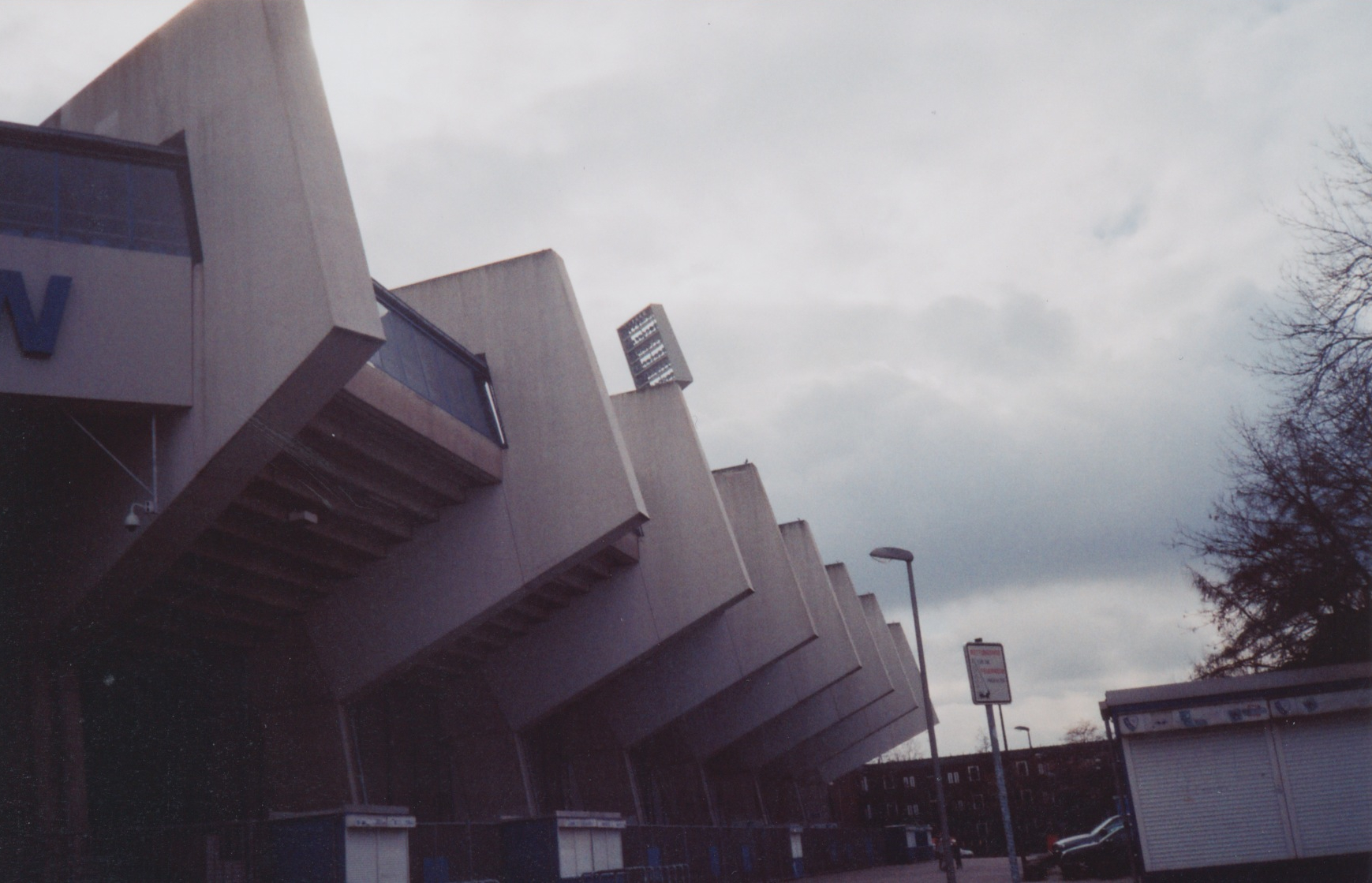 Heading to Dortmund Airport and noticing some floodlights behind some shops, our intrepid taxi driver takes a detour to show us Bochum FCs Ruhrstadion. We do love brutalist concrete architecture, as must the taxi driver.