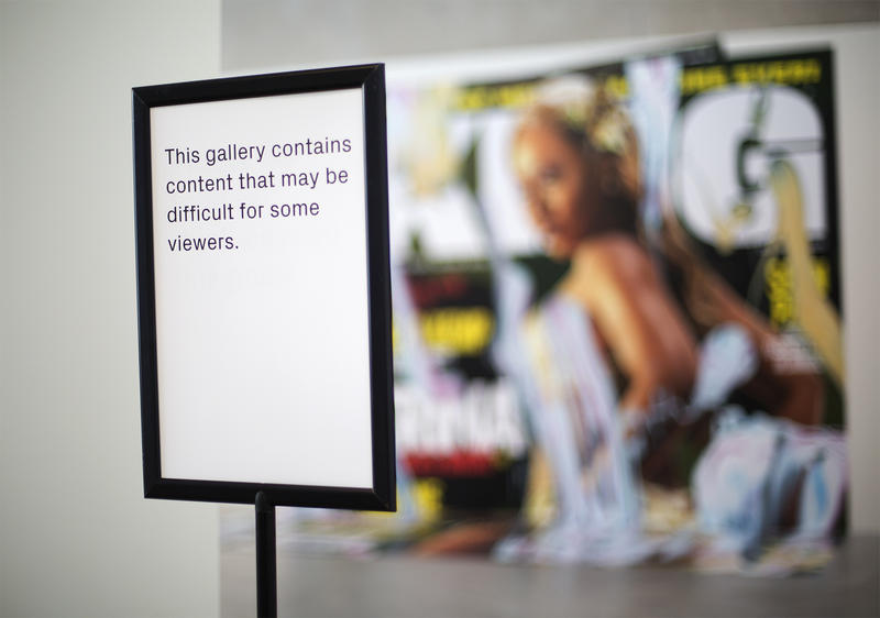 Visitors to the Contemporary Art Museum are now (Sept. 30, 2016) greeted by warning signs and a wall that went up in front of Kelley Walker's Direct Drive exhibit following criticism and outrage of the work. CAROLINA HIDALGO | ST. LOUIS PUBLIC RADIO