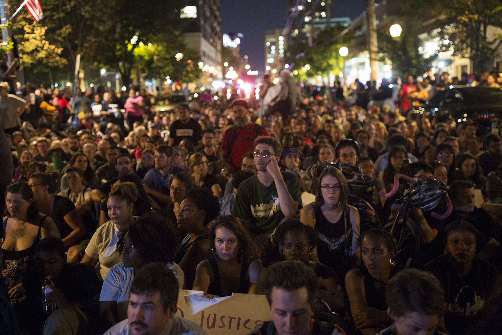 Protesters sit at the intersection of Maryland and Euclid for a moment of silence on Friday, Sept. 15. CAROLINA HIDALGO | ST. LOUIS PUBLIC RADIO