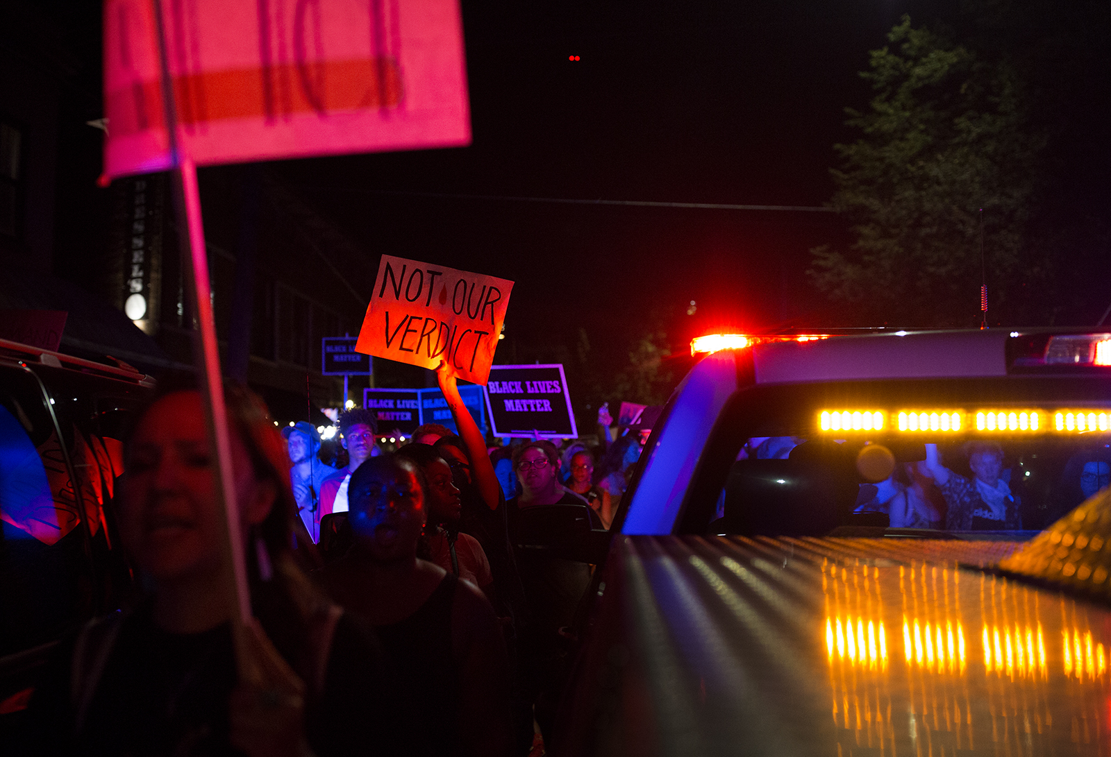 Demonstrators march through the Central West End neighborhood Sept. 15 after a judge acquitted former police officer Jason Stockley, charged with murder in the shooting death of Anthony Lamar Smith. CAROLINA HIDALGO | ST LOUIS PUBLIC RADIO