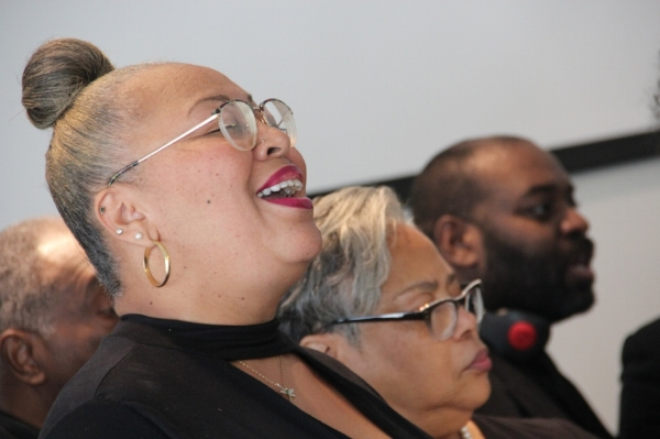 "A member of the Legend Singers performs during the ""Out of the Ville"" listening party hosted by We Live Here in partnership with 4TheVille, a community group based in the historic Ville neighborhood. Photo Credit: Producer TIm Lloyd"
