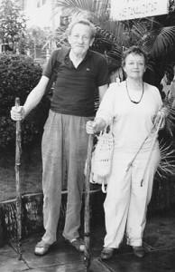 John and Anne Summerfield outside their hotel in Batu Sangkar, West Sumatra, after a trek through the hills to a macrame village.
