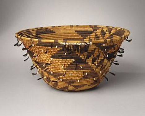 Girl's Coiled Dowry or Puberty Basket (kol-chu or ti-ri-bu-ku), late 19th century. Willow, sedge root, bulrush root, acorn woodpecker scalp feather, California valley quail topknot feather,oilivella biplicata shell, cotton string, 7 x 14 1/2 x 14 1/2 in. (17.8 x 36.8 x 36.8 cm). Brooklyn Museum