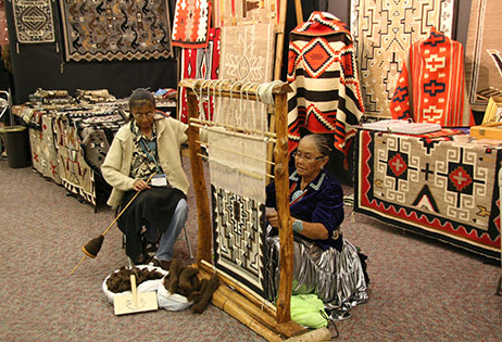 Navajo Weavers from Toadlena, at the loom, Old West Show.