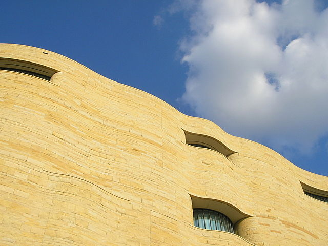 Side of the National Museum of American Indian in Washington, D.C., Author Aguebor, 10 September 2017. Wikimedia Commons.