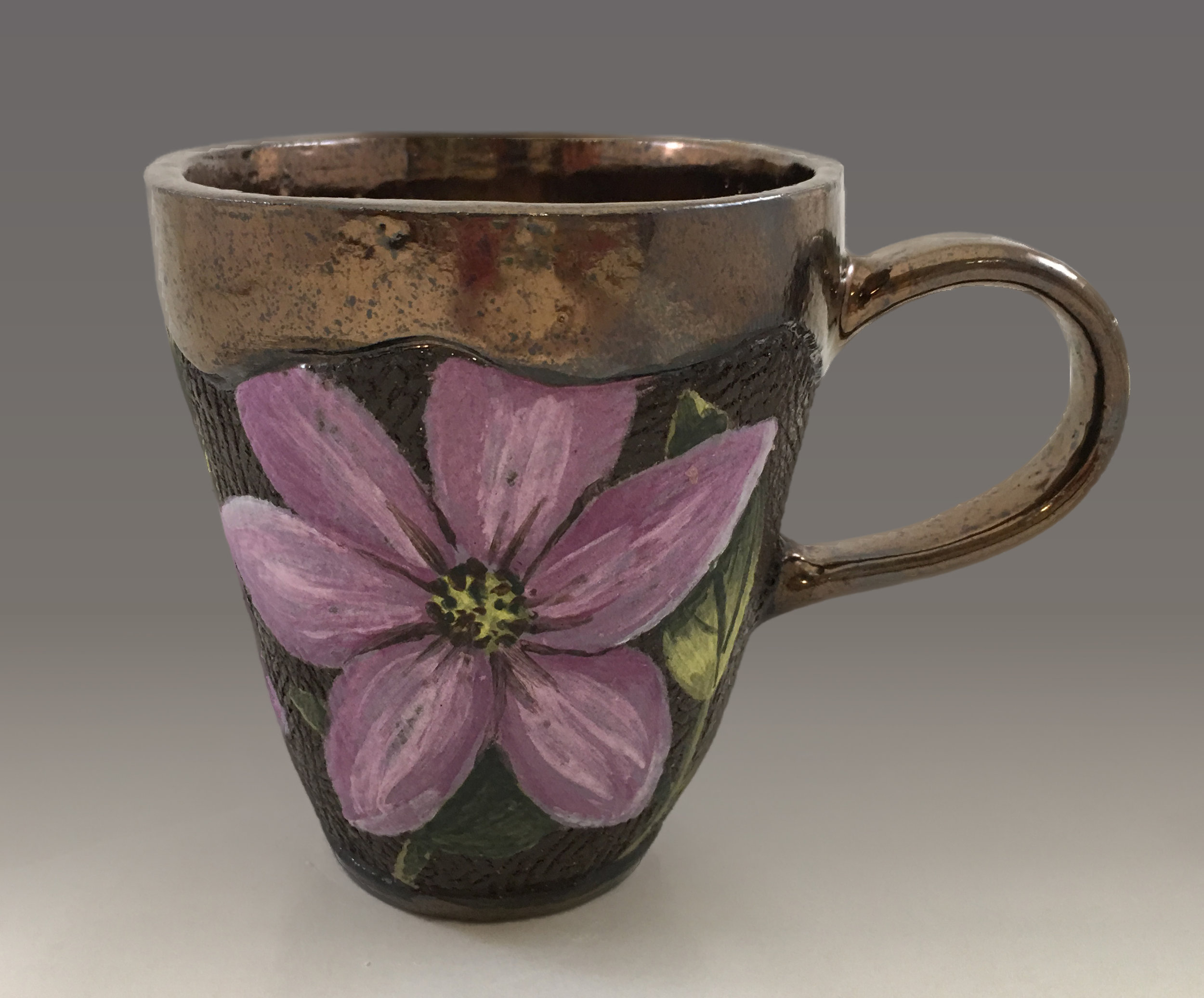Cup with Clematis Flowers