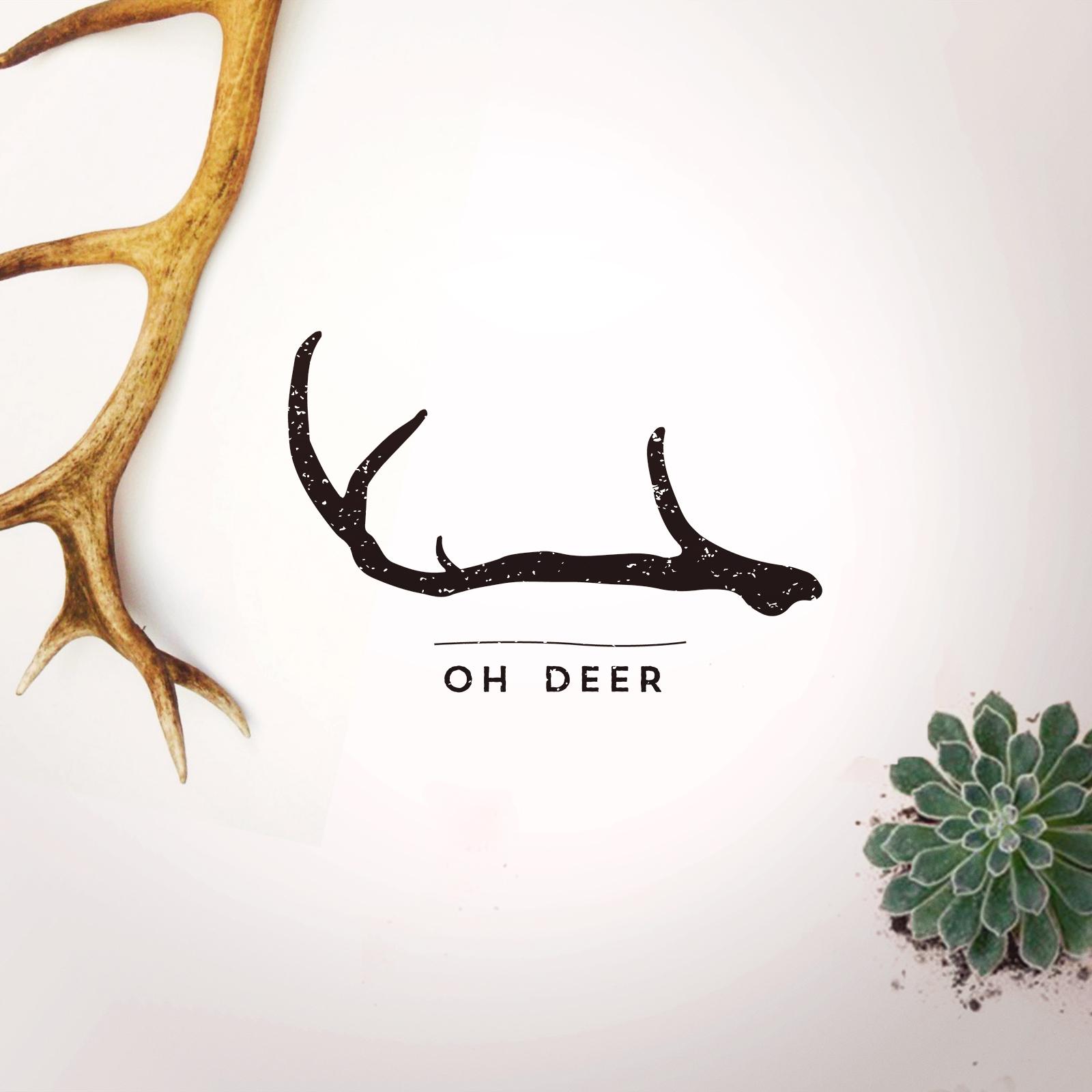 Oh deer logo on white background with black antler above lettering