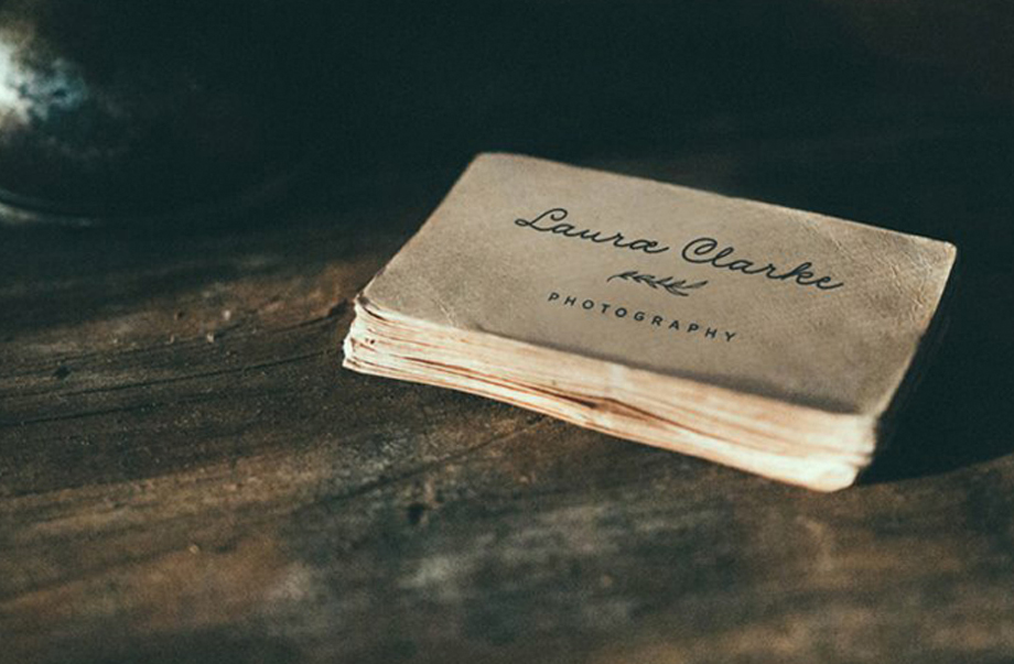 Laura Clarke photography business cards on rustic paper
