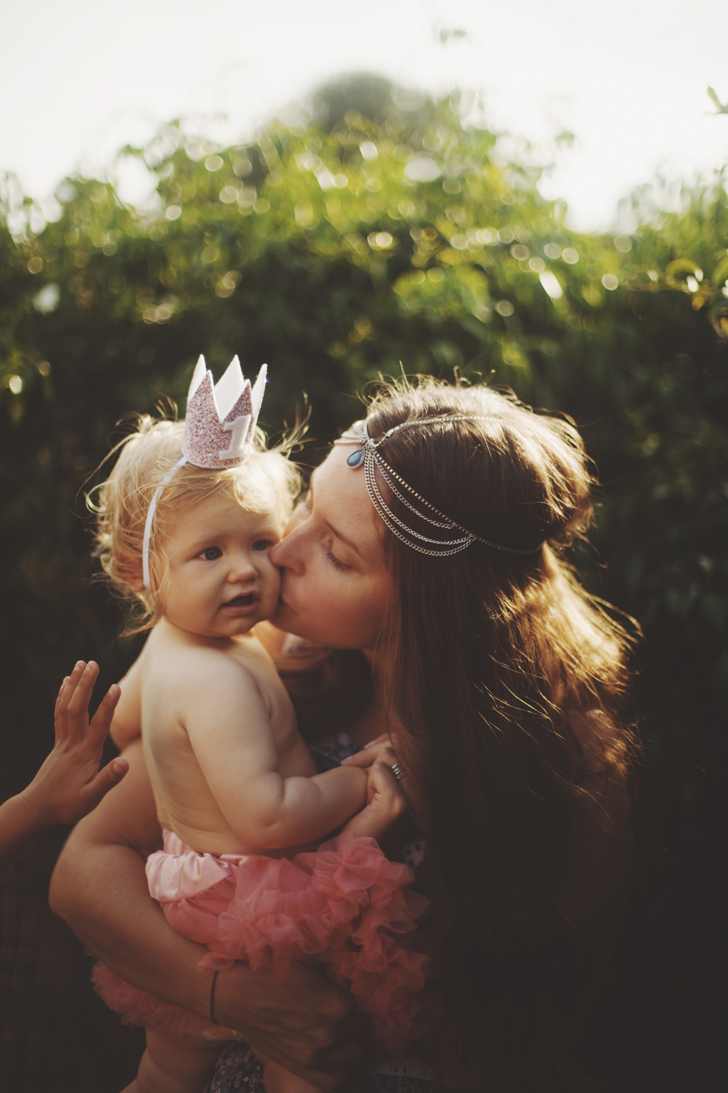 Mother and baby at first birthday party