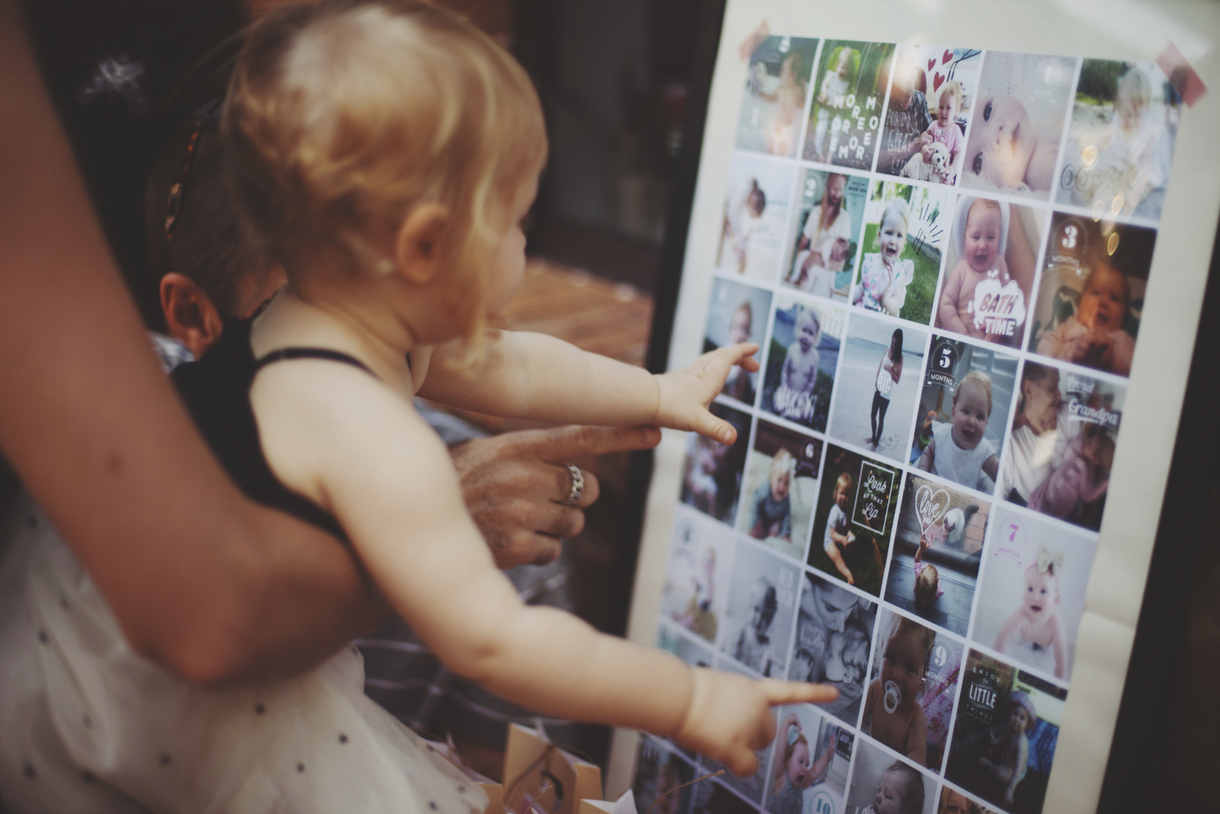 baby looking at images on collage