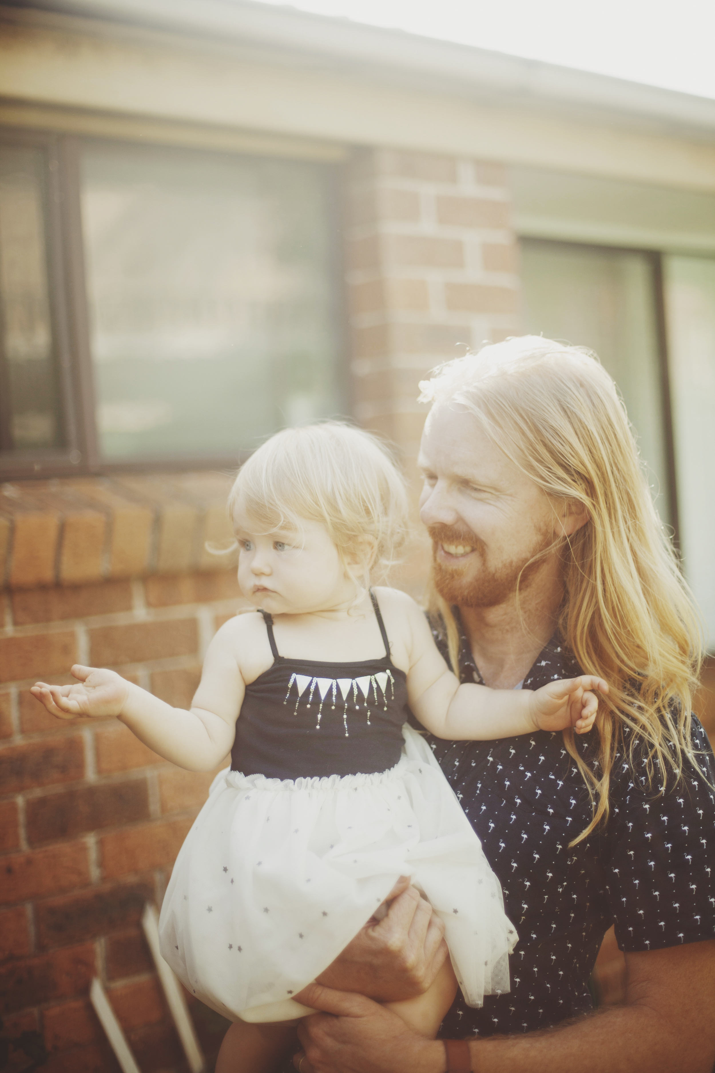 father and daughter at first birthday