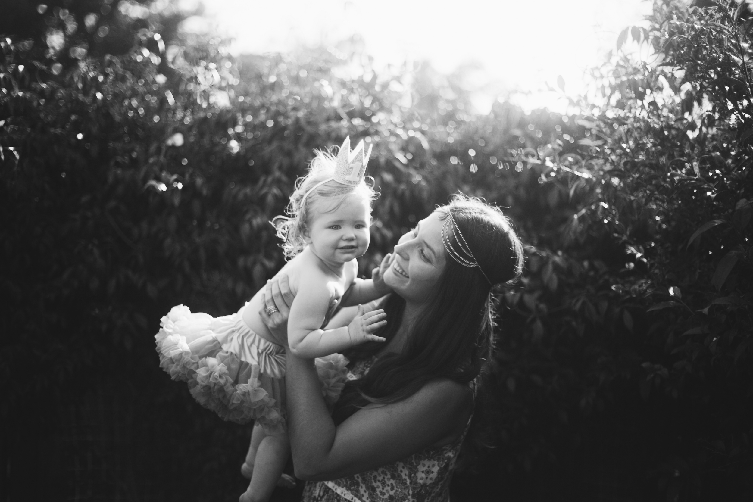 Baby wearing tutu and birthday at at first birthday party