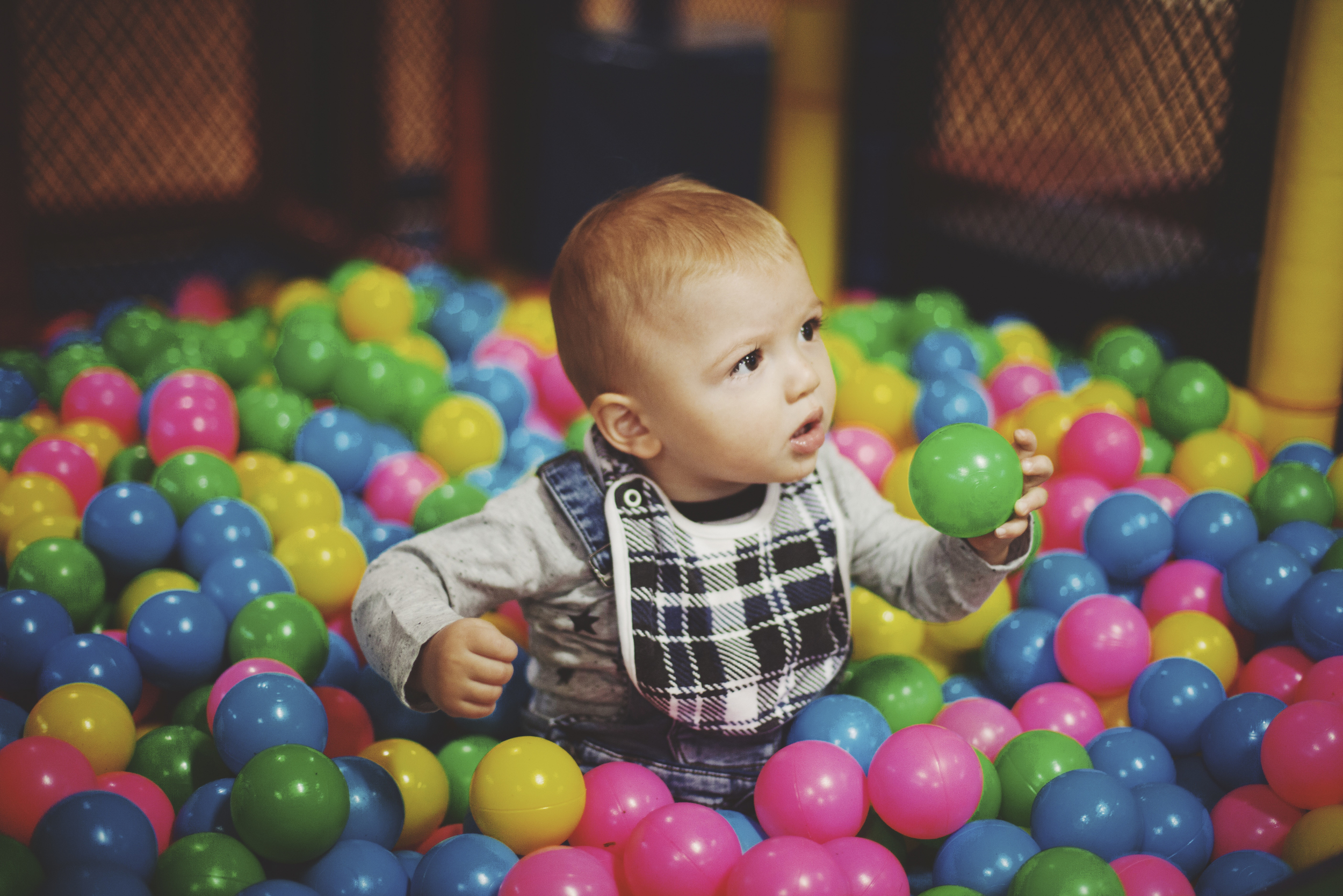 child in ball pit