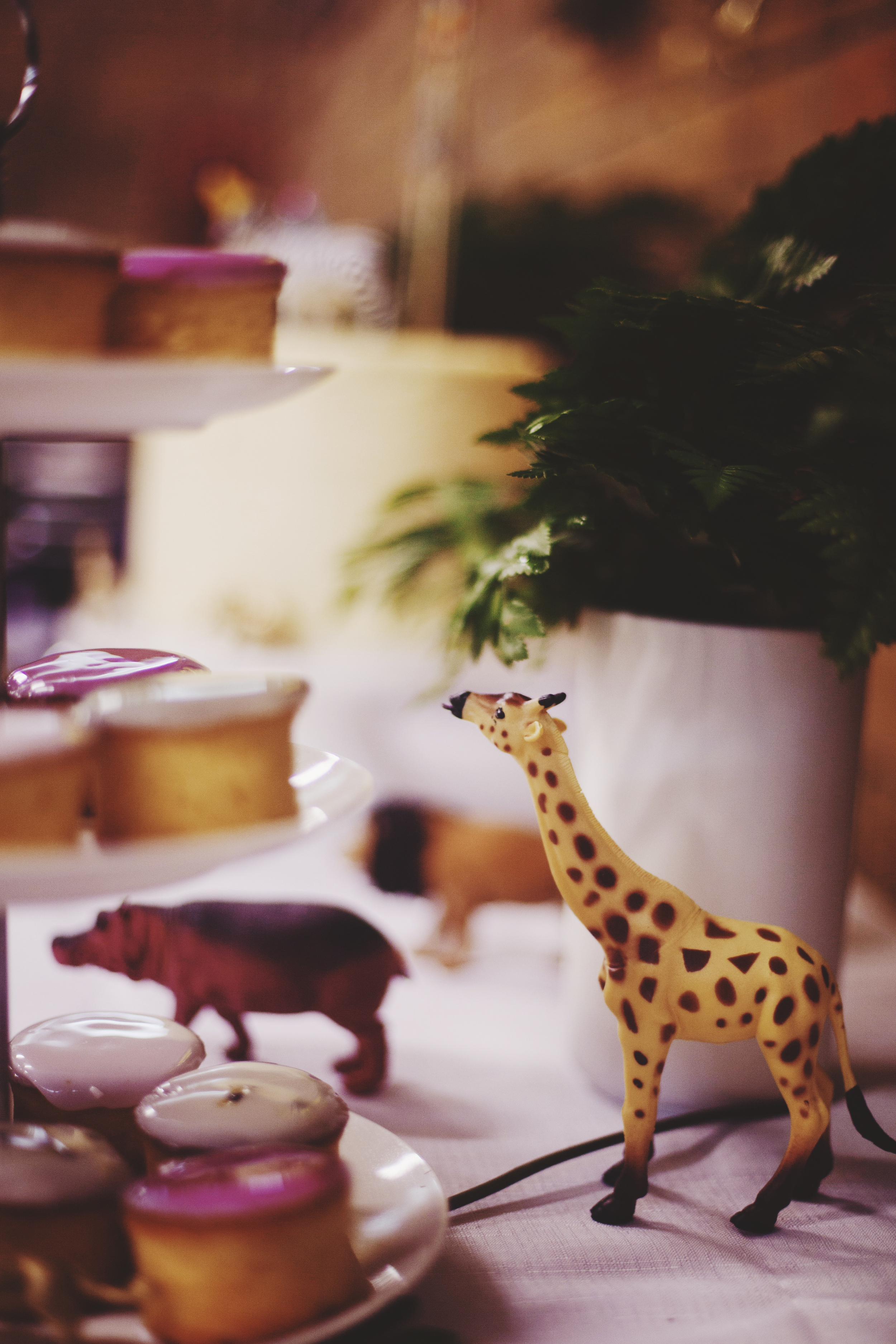 animal figurines on table at first birthday party