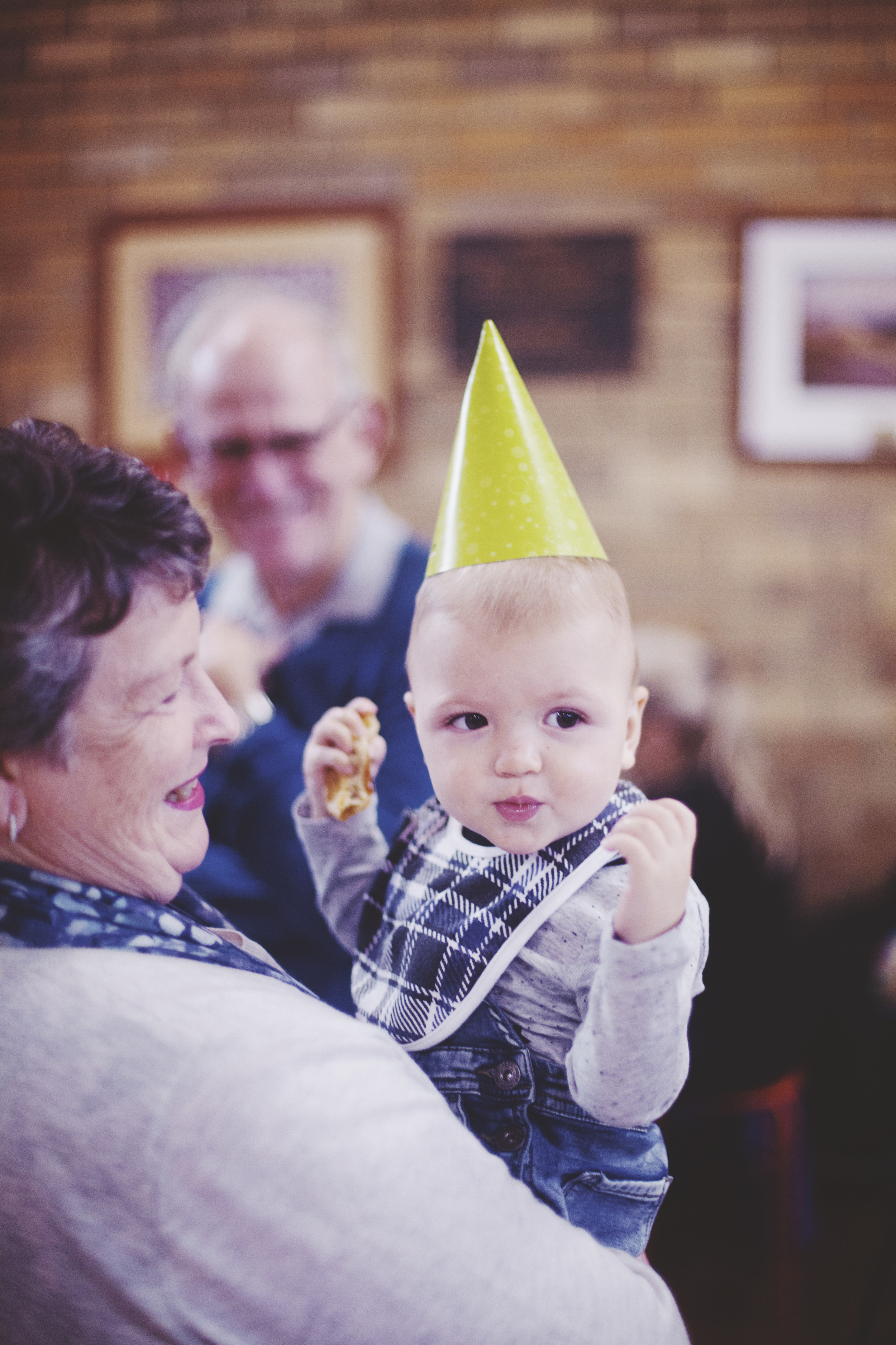 baby wearing lime green party hat