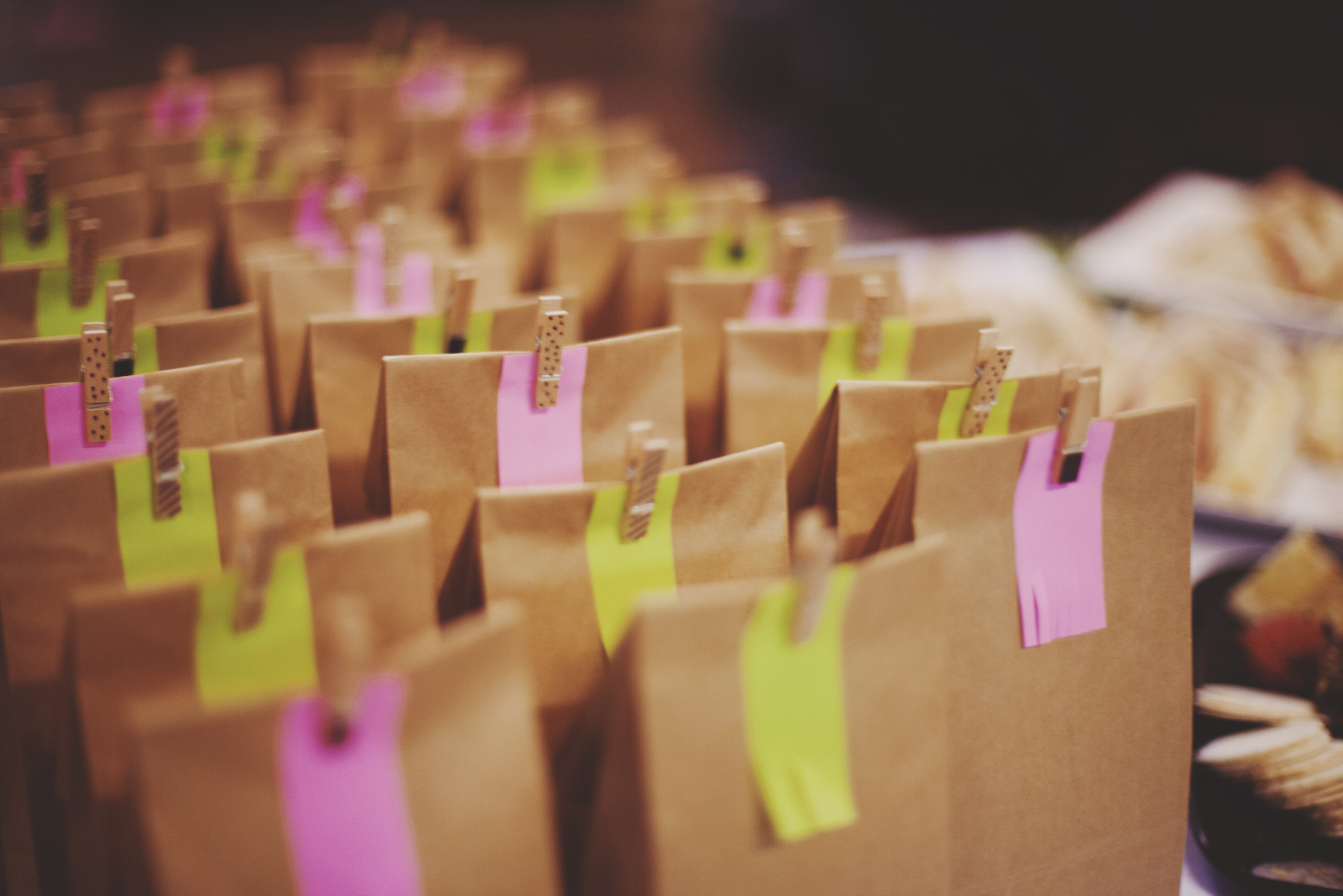 brown lolly bags with pink and green tags