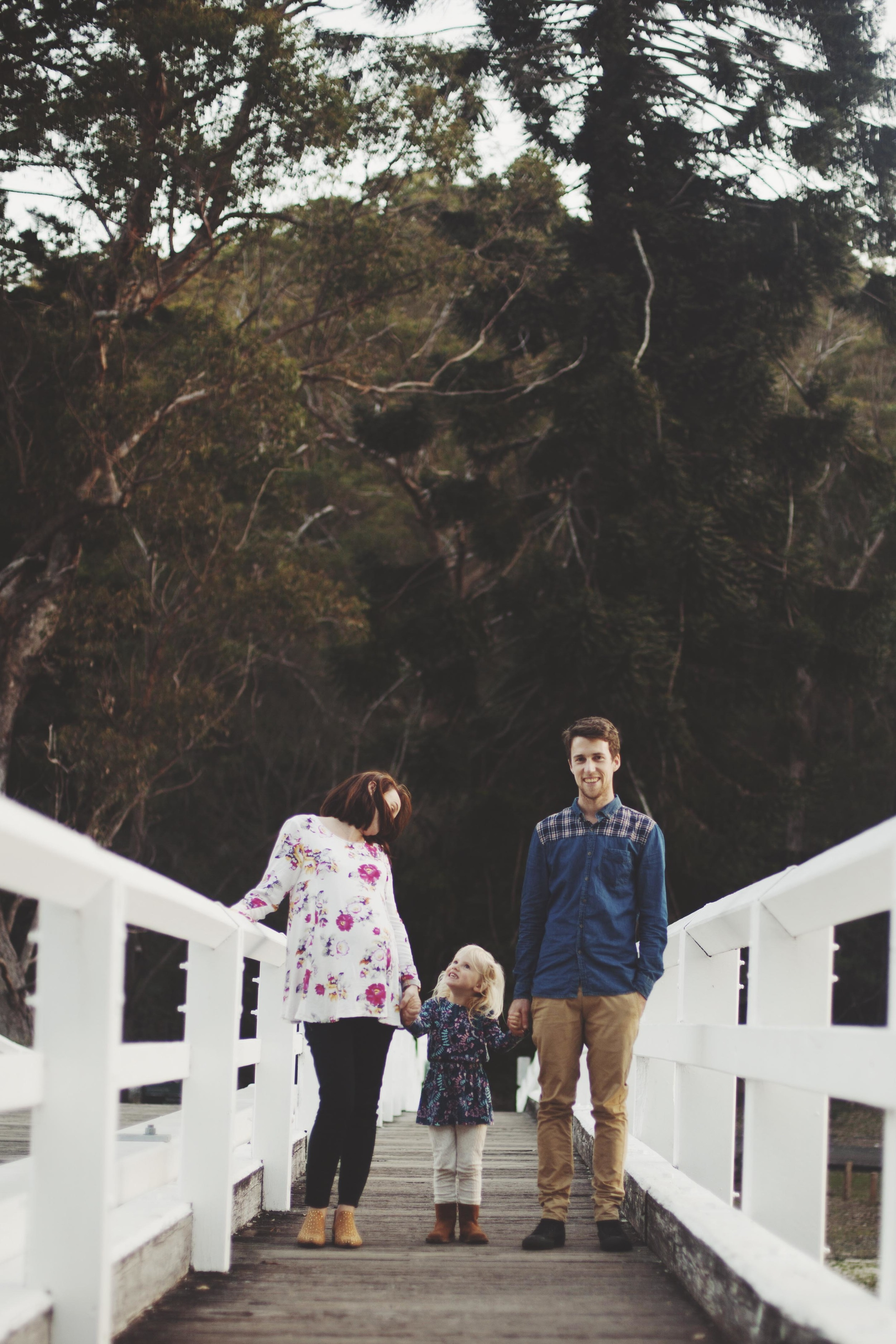 family walking on wooden bridge in sydneys royal national park