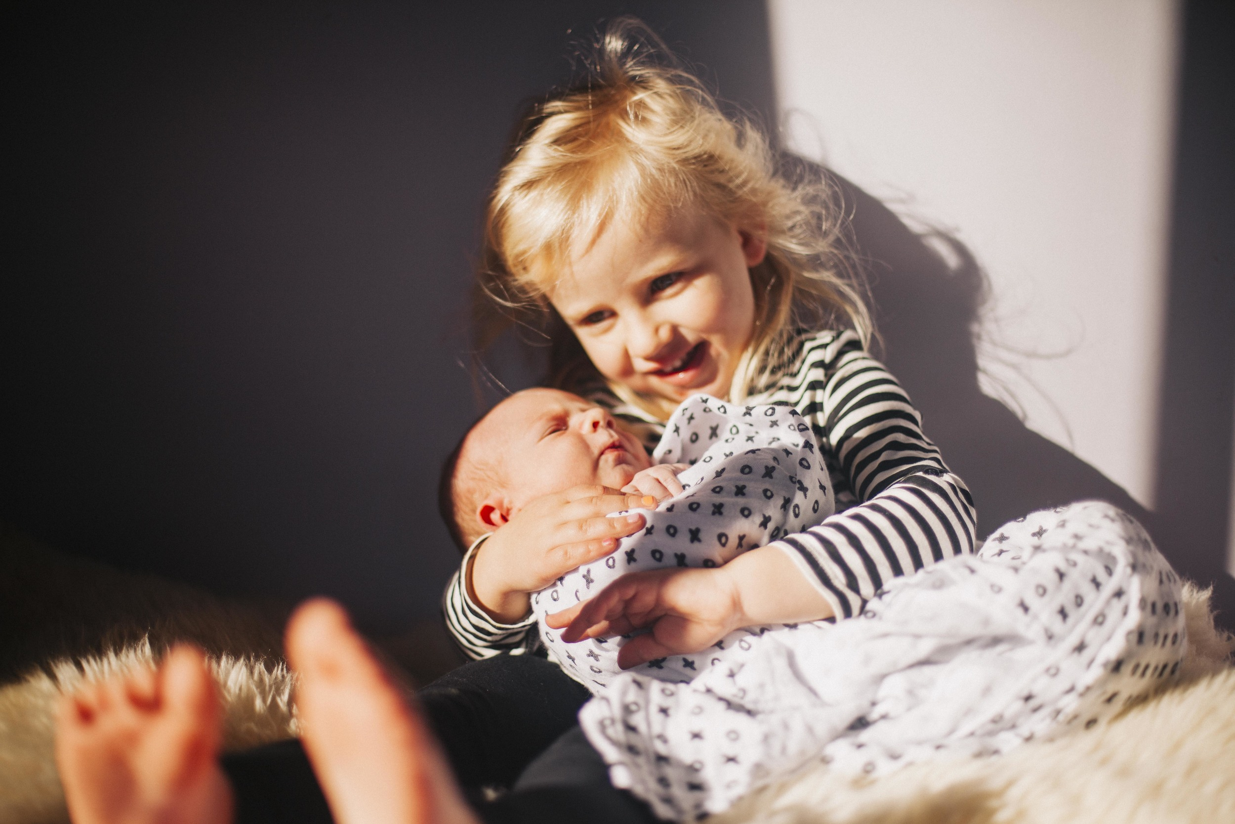 big sister holding little brother