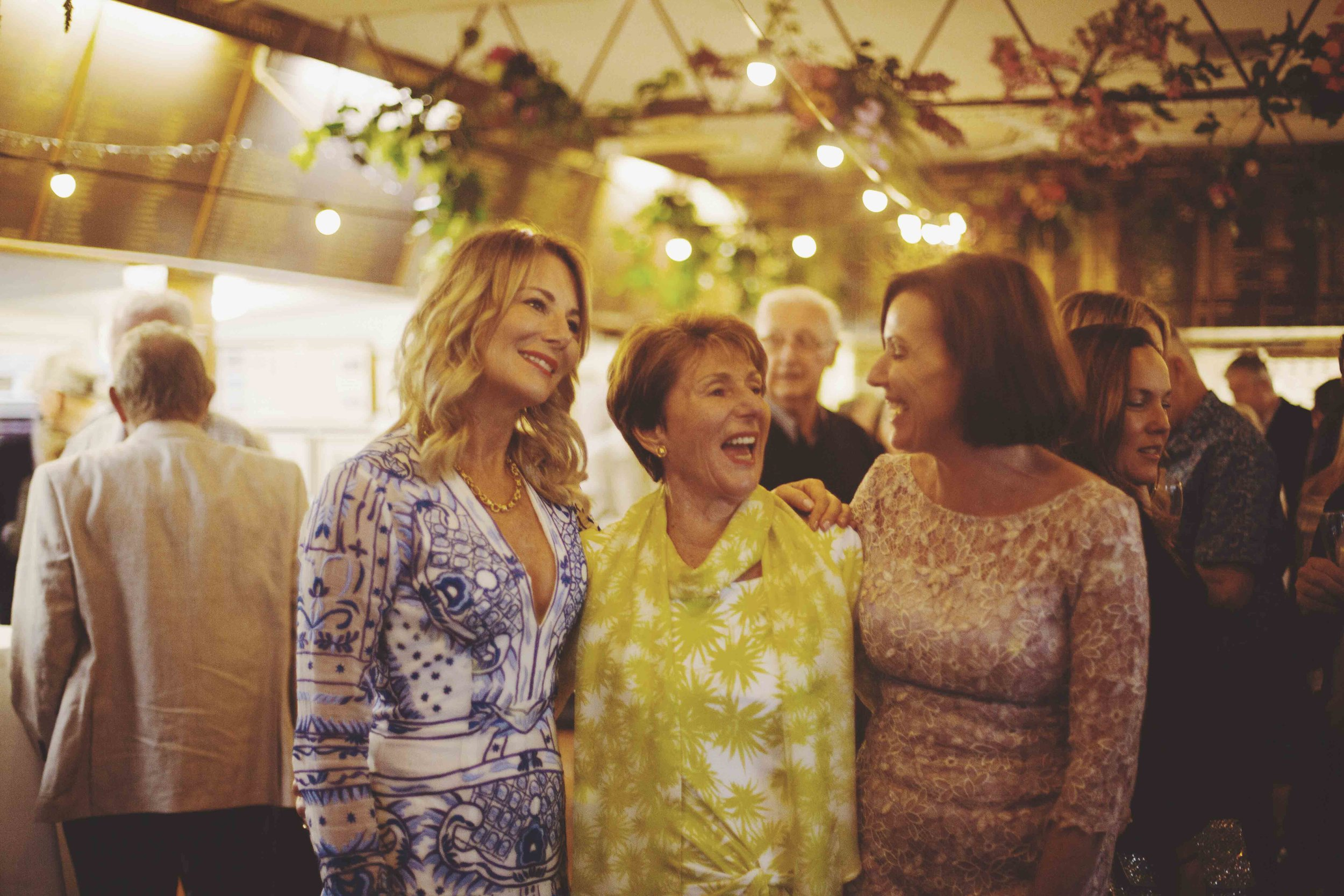 Group of women laughing at 80th birthday party