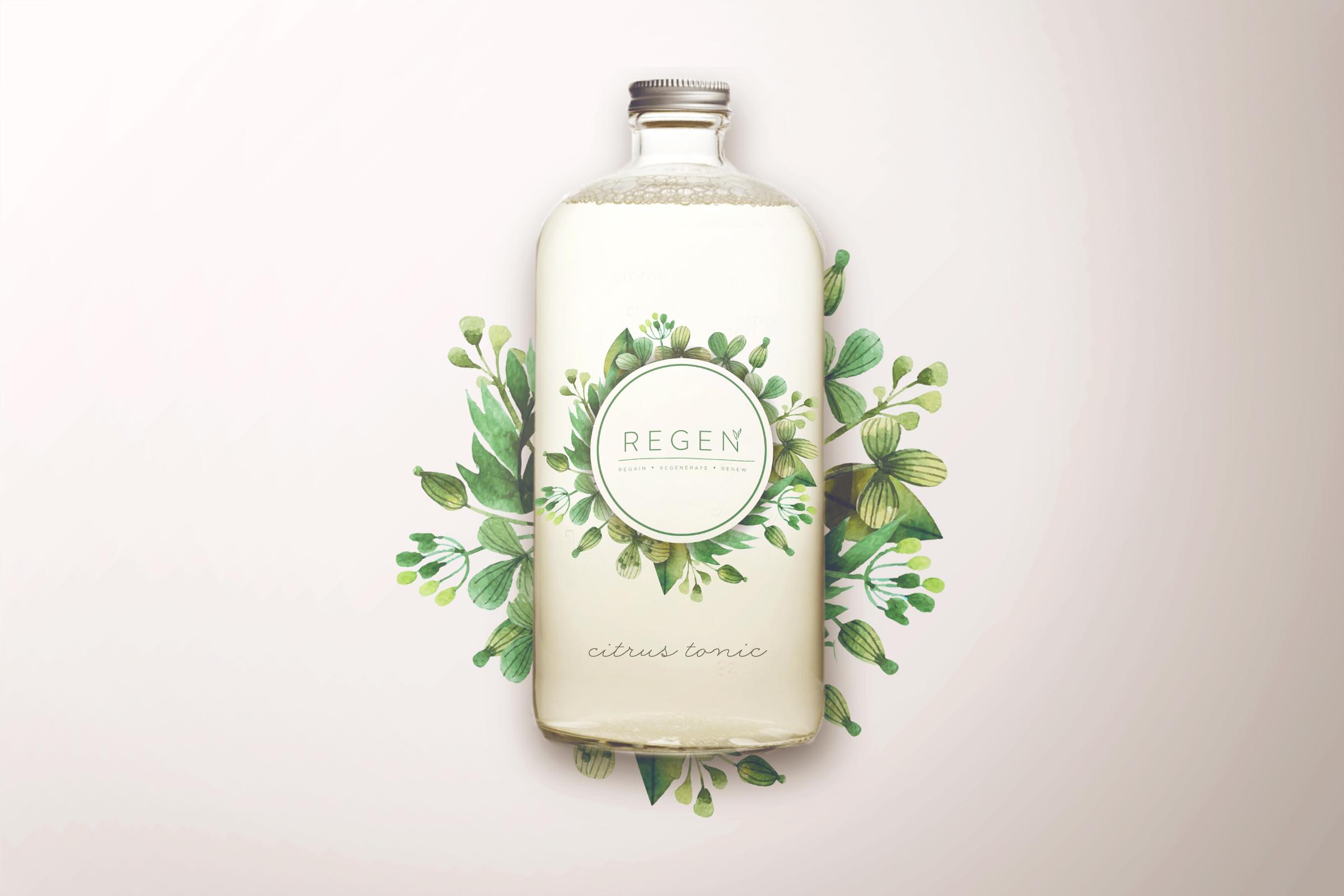 Regen citrus tonic branding printed on bottle with florals surrounding