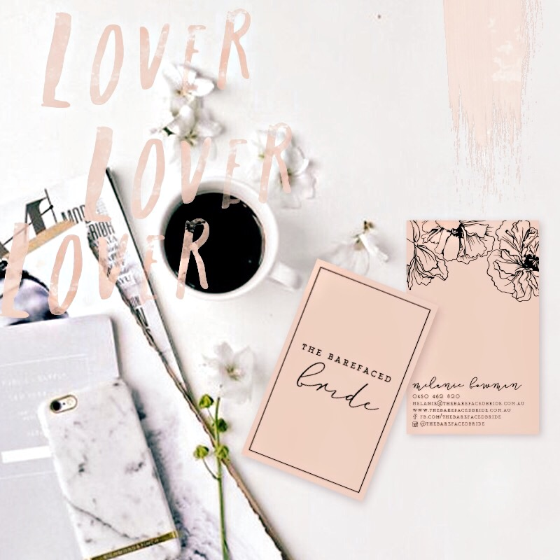 Flatlay on white table with coffee, iphone and peach coloured business cards