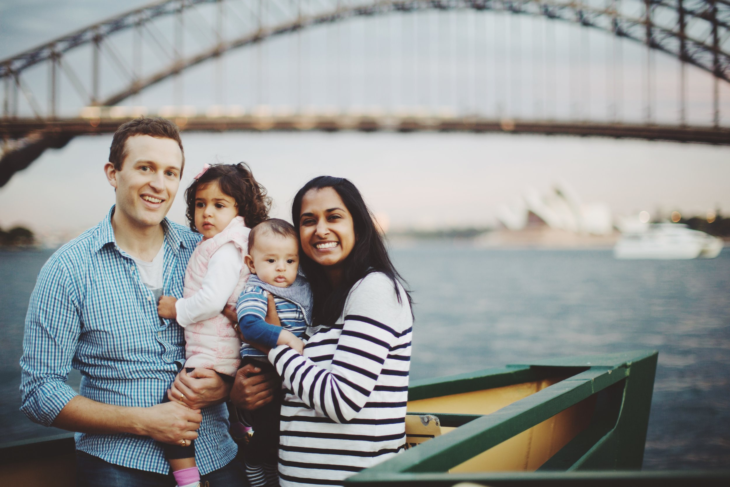 Family walking by harbour in Sydney