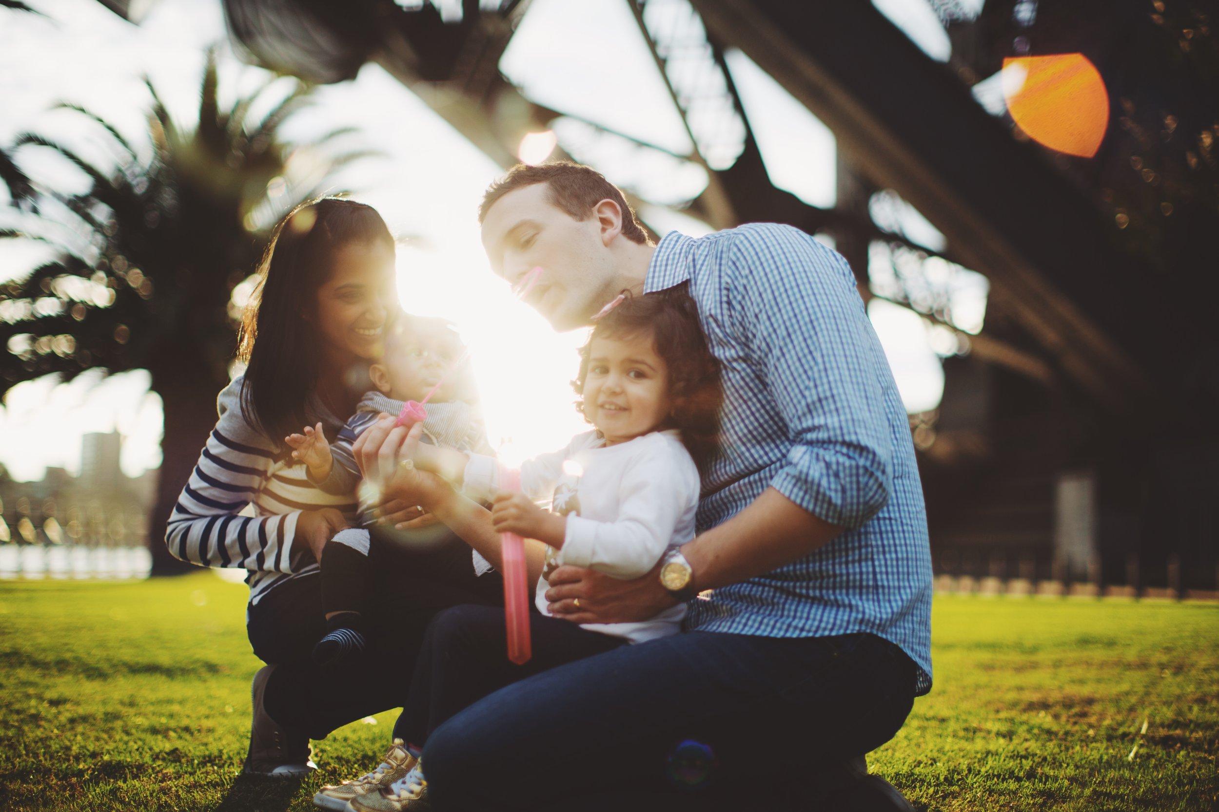 Family standing below Sydney Harbour Bridge