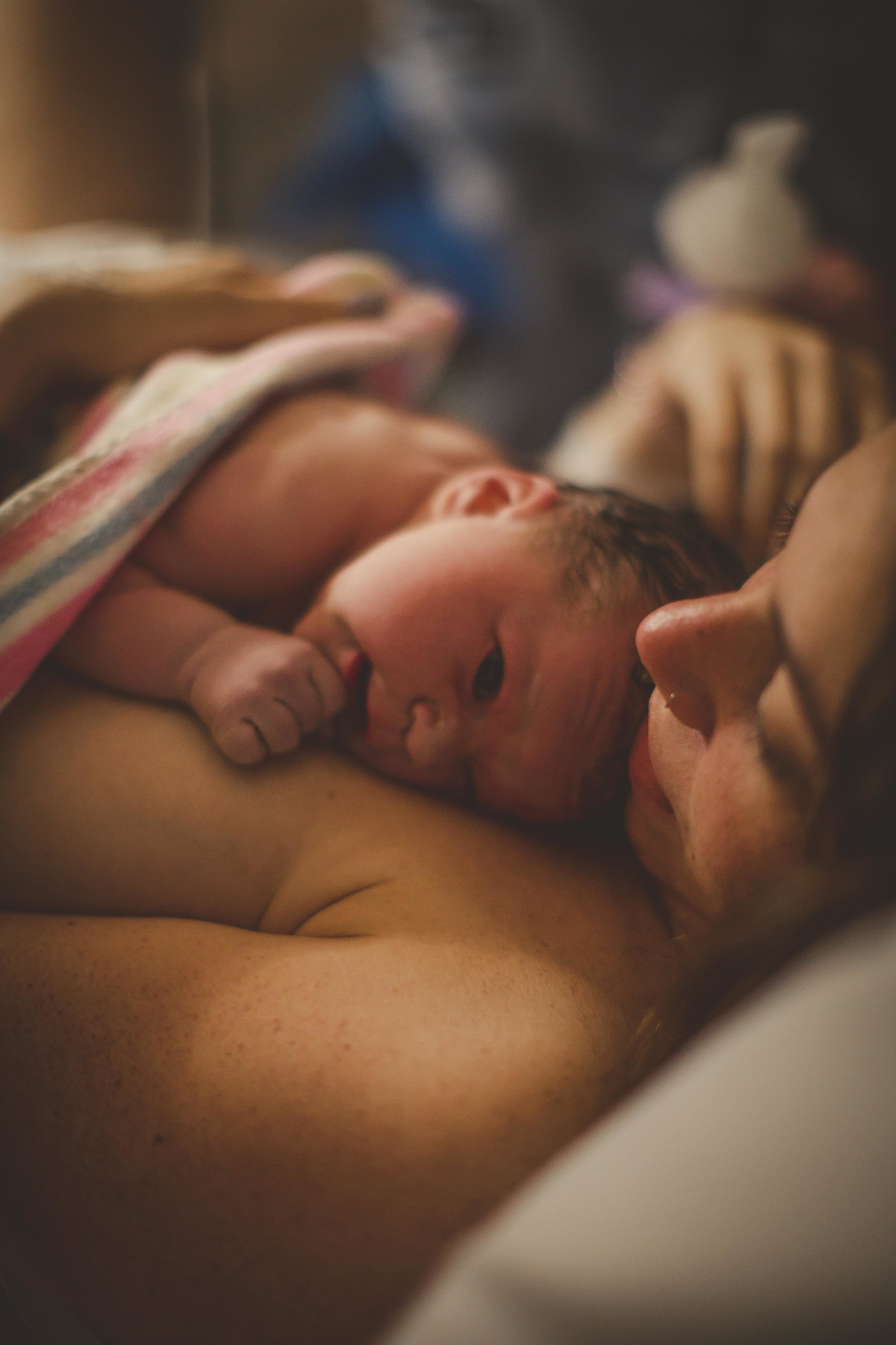 newborn resting on mother's chest after birth