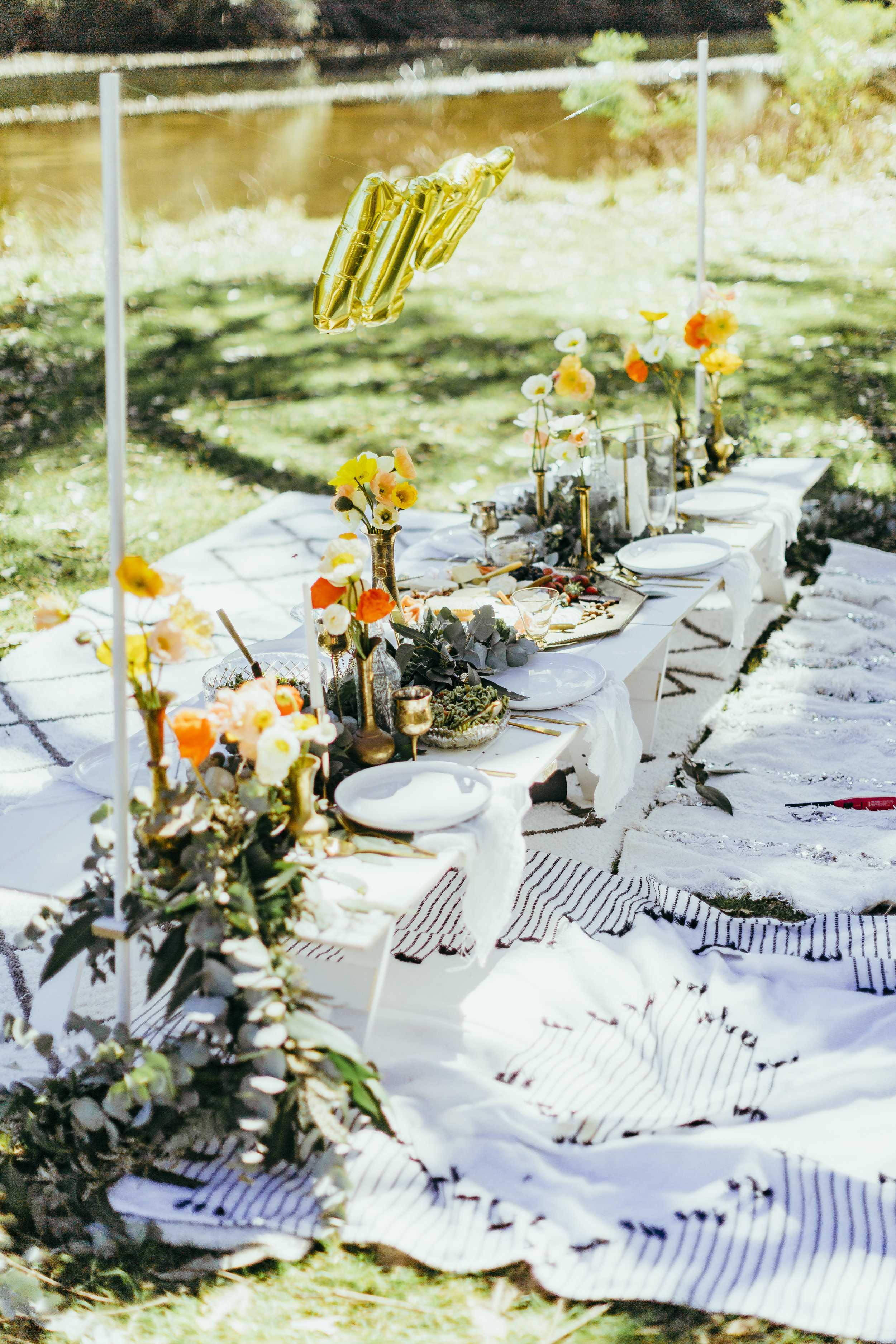 Birthday party styled with floral table settings, grazing plates, chocolate meringue, flower crowns and confetti