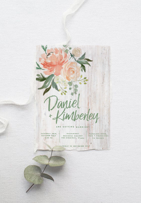 peach and green foliage wedding stationery with wood background