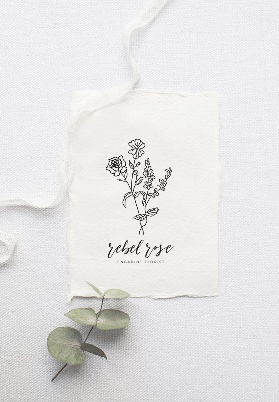 Rebel rose logo with blue lettering and navy florals