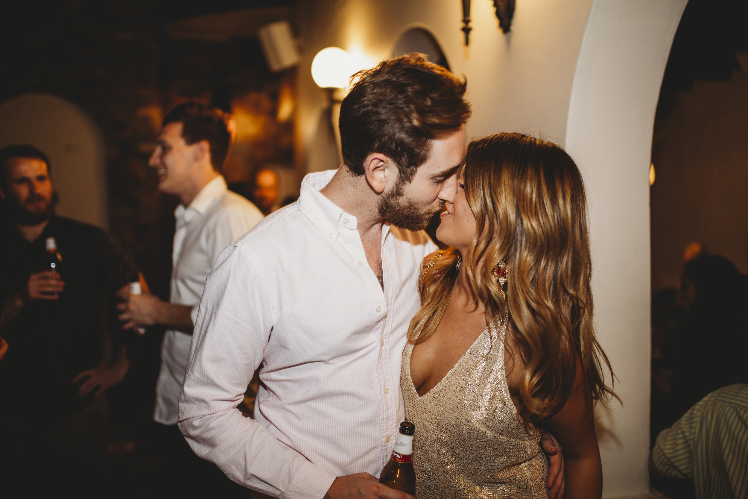 Young couple kissing at party